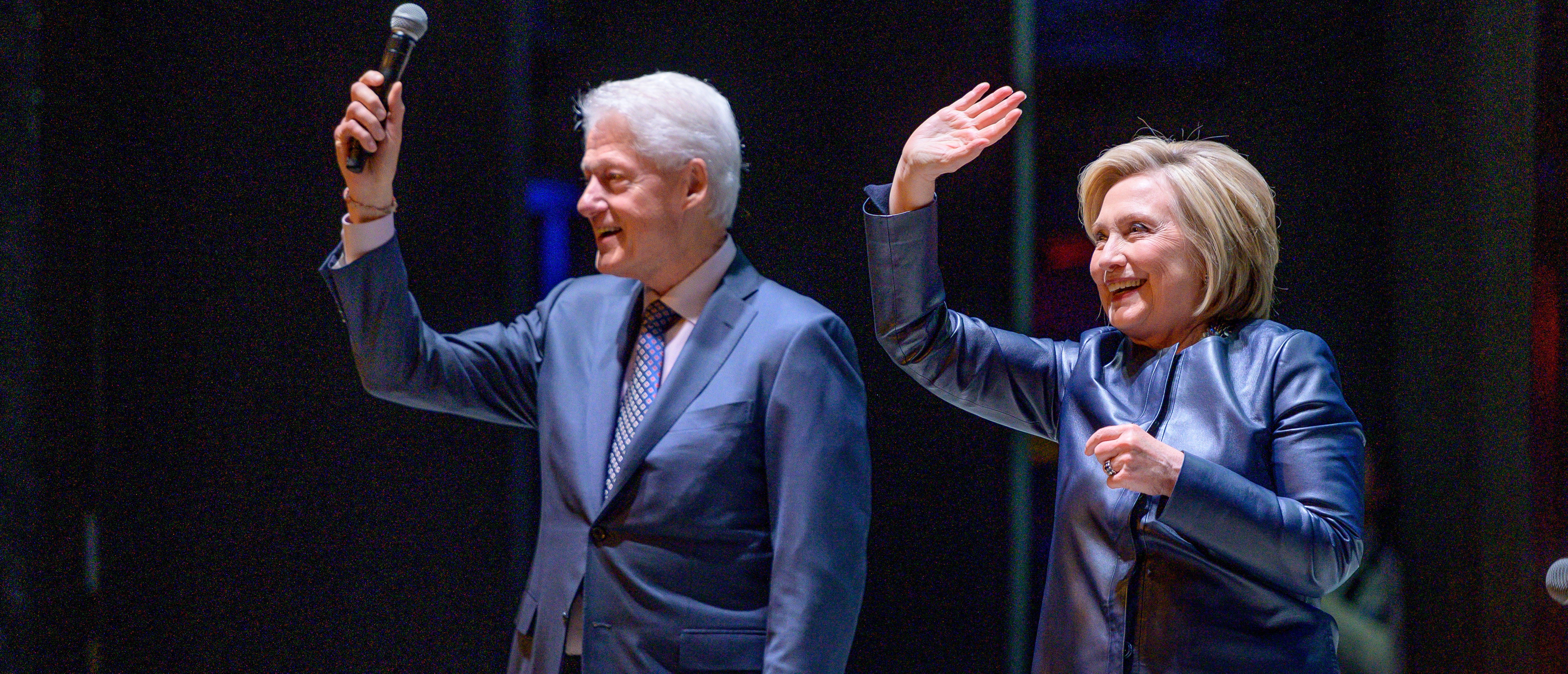 "NEW YORK, NEW YORK - APRIL 11: Former President of the United States Bill Clinton with his wife, Former Secretary of State and presidential candidate Hillary Clinton on Stage during ""An Evening With The Clintons"" at Beacon Theatre on April 11, 2019 in New York City. (Photo by Roy Rochlin/Getty Images)"
