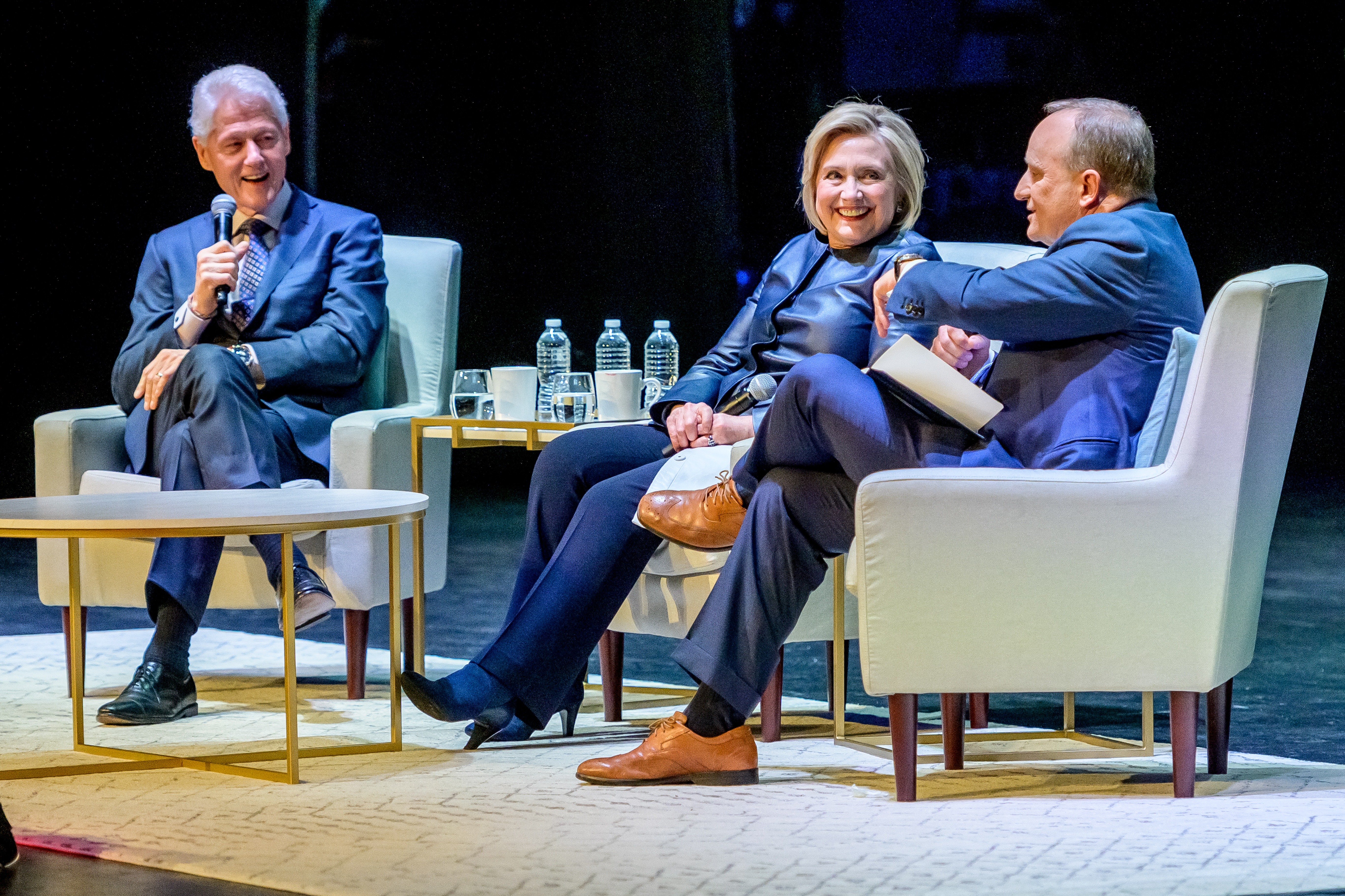"NEW YORK, NEW YORK - APRIL 11: Former President of the United States Bill Clinton with his wife, Former Secretary of State and presidential candidate Hillary Clinton and moderator Paul Begala on Stage during ""An Evening With The Clintons"" at Beacon Theatre on April 11, 2019 in New York City. (Photo by Roy Rochlin/Getty Images)"
