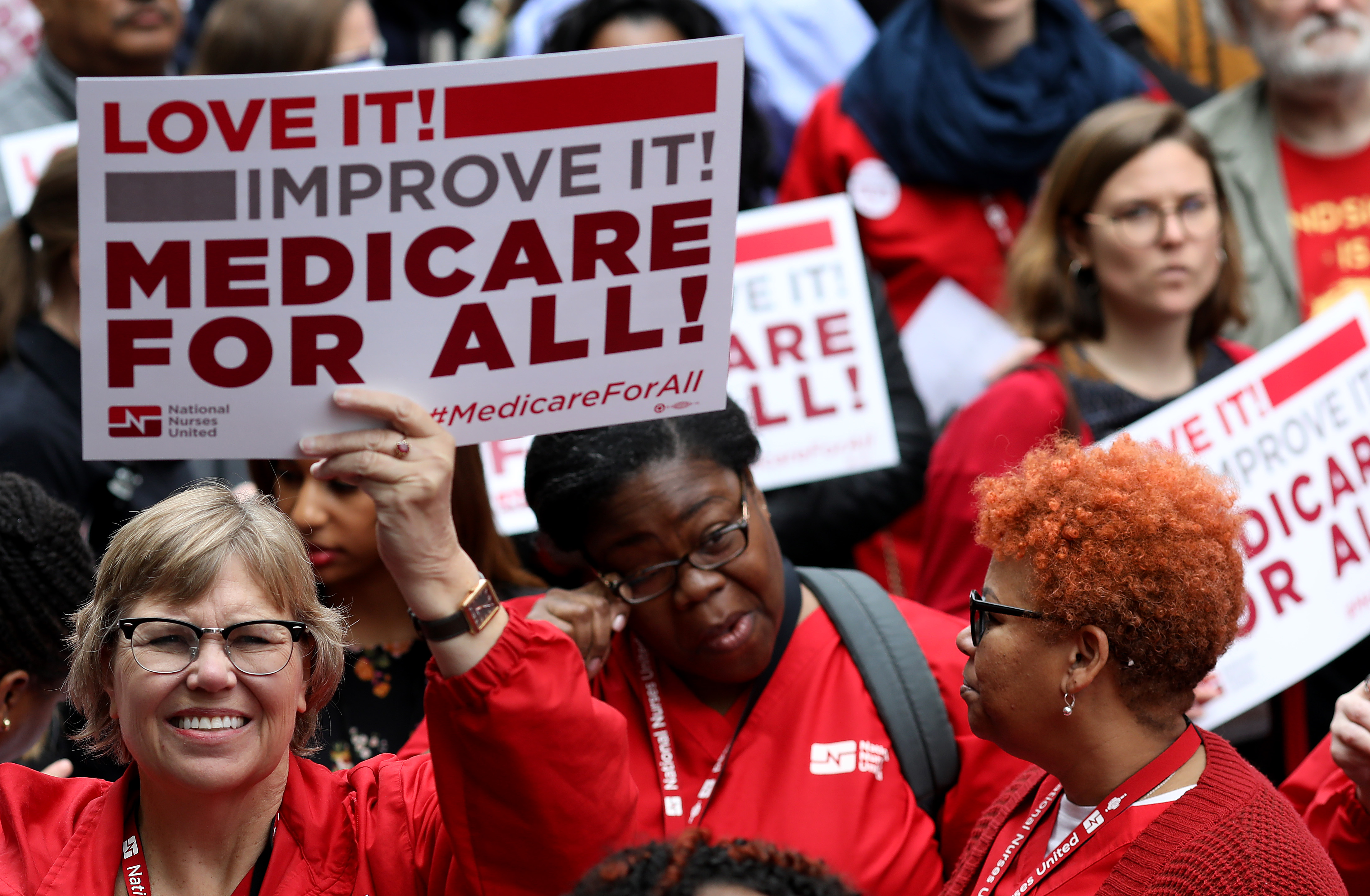 """Protesters supporting """"Medicare for All"""" hold a rally outside PhRMA headquarters April 29, 2019 in Washington, DC. (Photo by Win McNamee/Getty Images)"""