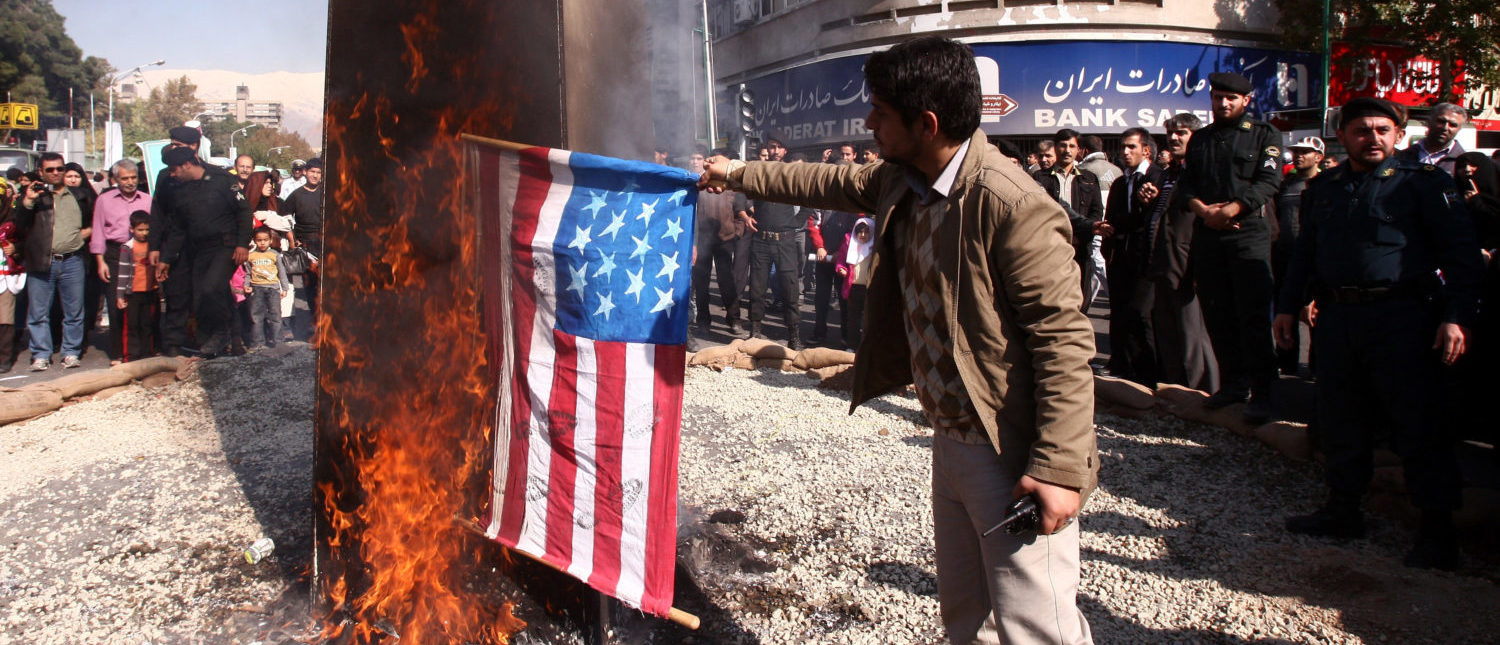 Iranian men burn a US flag outside the former US embassy in Tehran on November 4, 2011, during a rally to mark the storming of the American embassy by Iranian students 32 years ago. (Photo: ATTA KENARE/AFP/Getty Images)