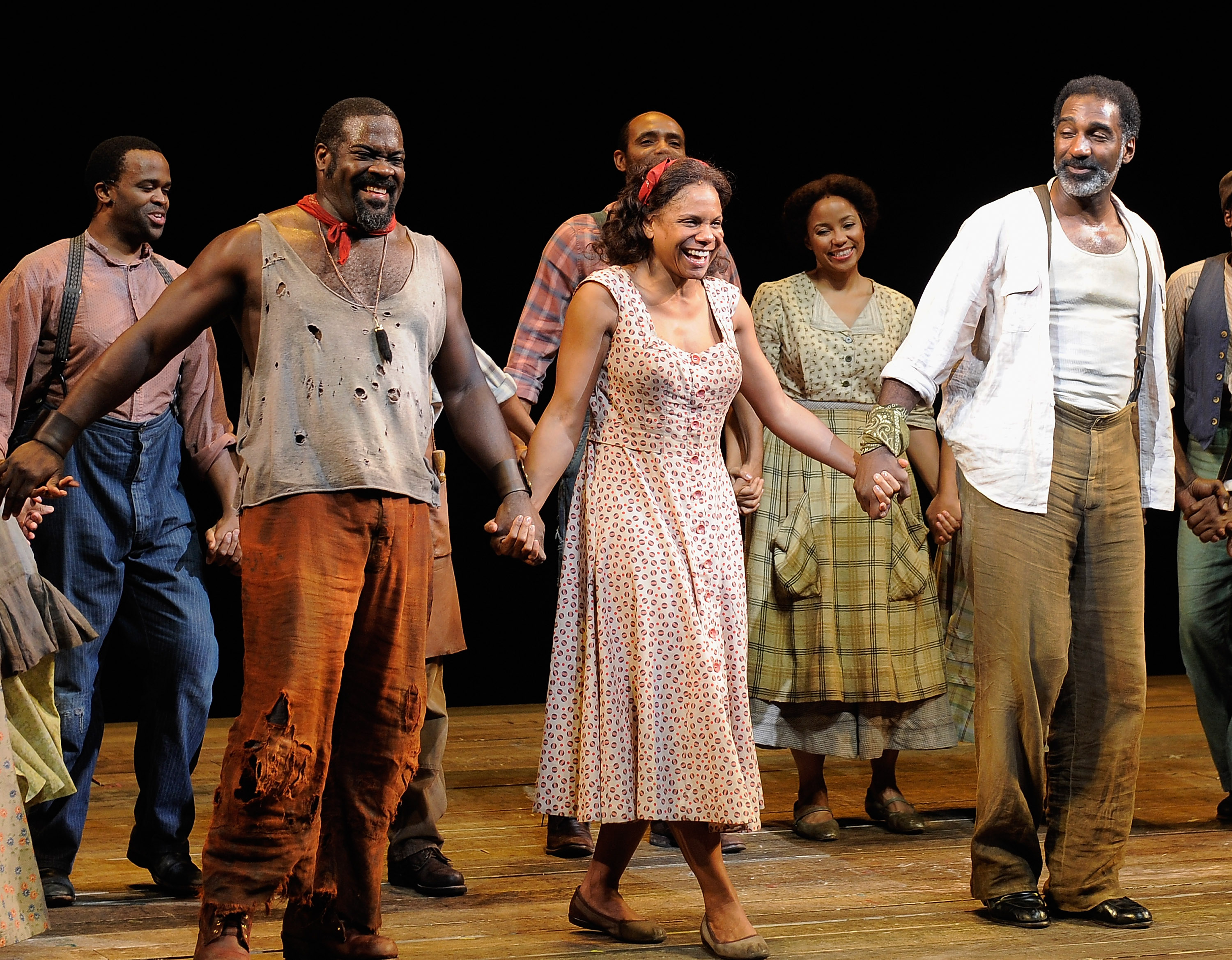 "NEW YORK, NY - JANUARY 12: (L-R) Actors Phillip Boykin, Audra McDonald and Norm Lewis join the cast to take a bow during the curtain call at ""The Gershwins' Porgy and Bess"" Broadway opening night at the Richard Rodgers Theatre on January 12, 2012 in New York City. (Photo by Jemal Countess/Getty Images)"