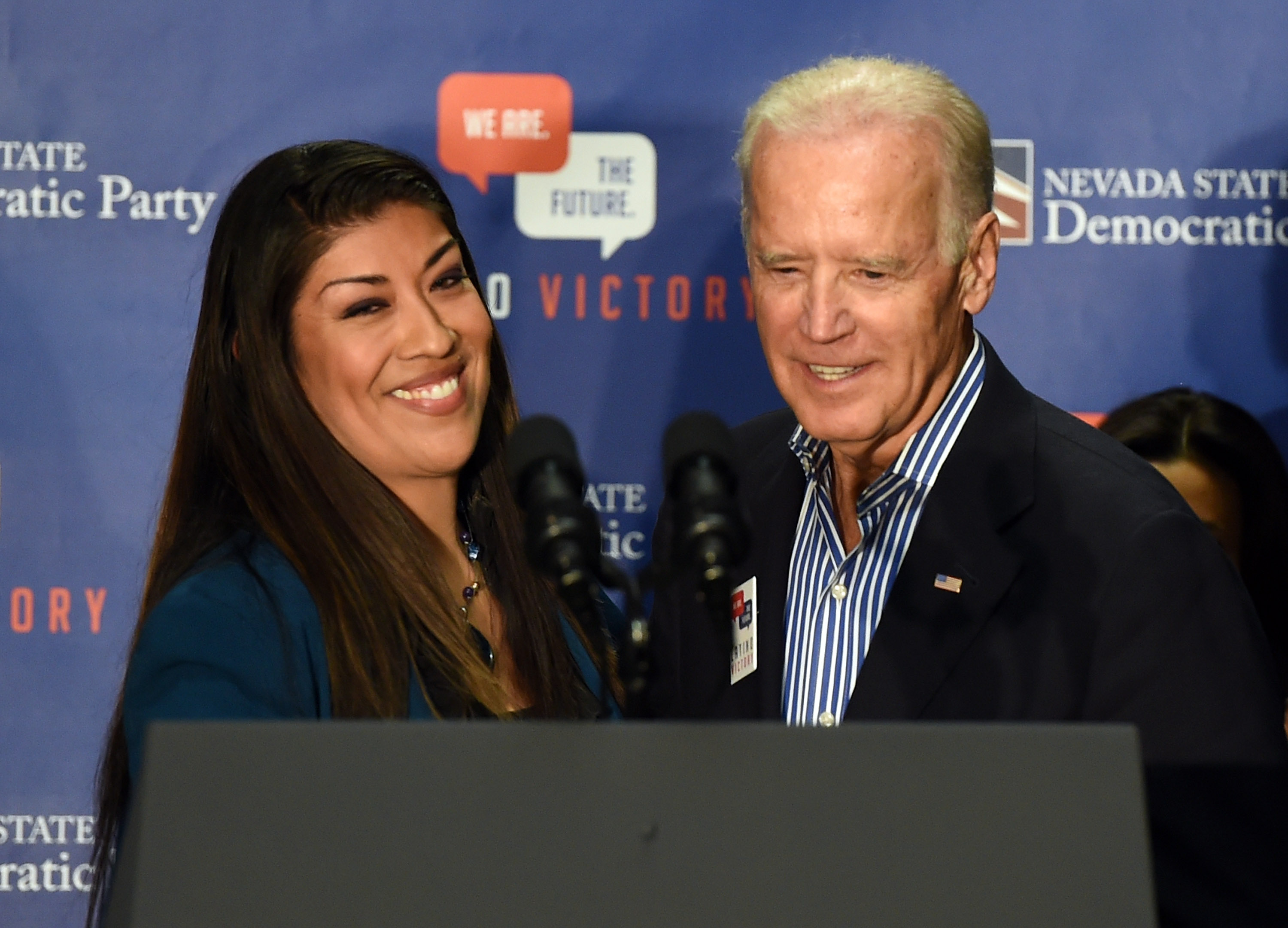 LAS VEGAS, NV - NOVEMBER 01: Democratic candidate for lieutenant governor and current Nevada Assemblywoman Lucy Flores (D-Las Vegas) (L) introduces U.S. Vice President Joe Biden at a get-out-the-vote rally at a union hall on November 1, 2014 in Las Vegas, Nevada. Biden is stumping for Nevada Democrats ahead of the November 4th election. (Photo by Ethan Miller/Getty Images)