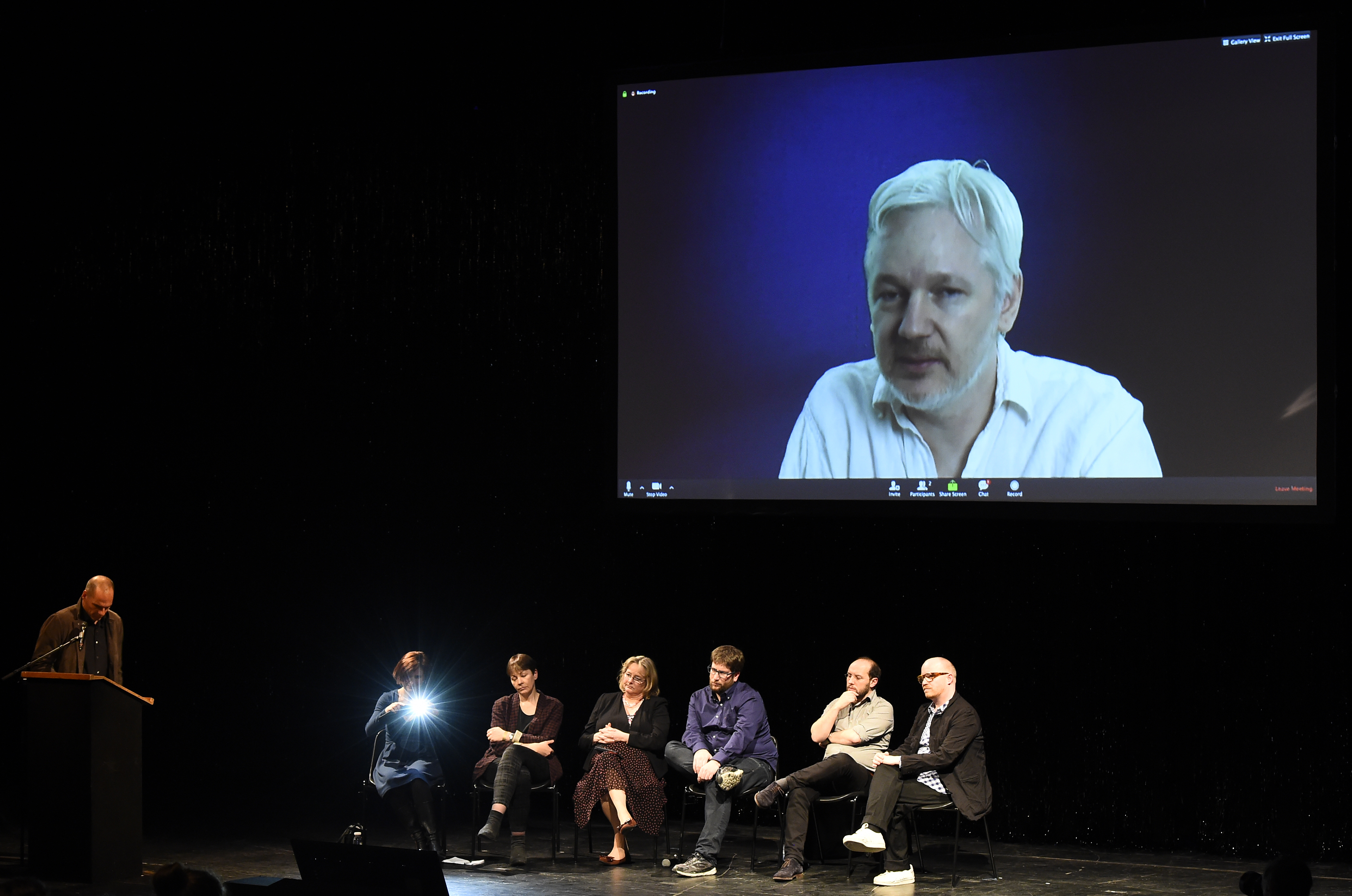 Greek former Finance Minister Yanis Varoufakis and other politicians listen to WikiLeaks founder Julian Assange speaking on a screen during an event to mark the official launch of the Democracy in Europe Movement (DiEM) in Berlin on February 9, 2016. (Photo: TOBIAS SCHWARZ/AFP/Getty Images)