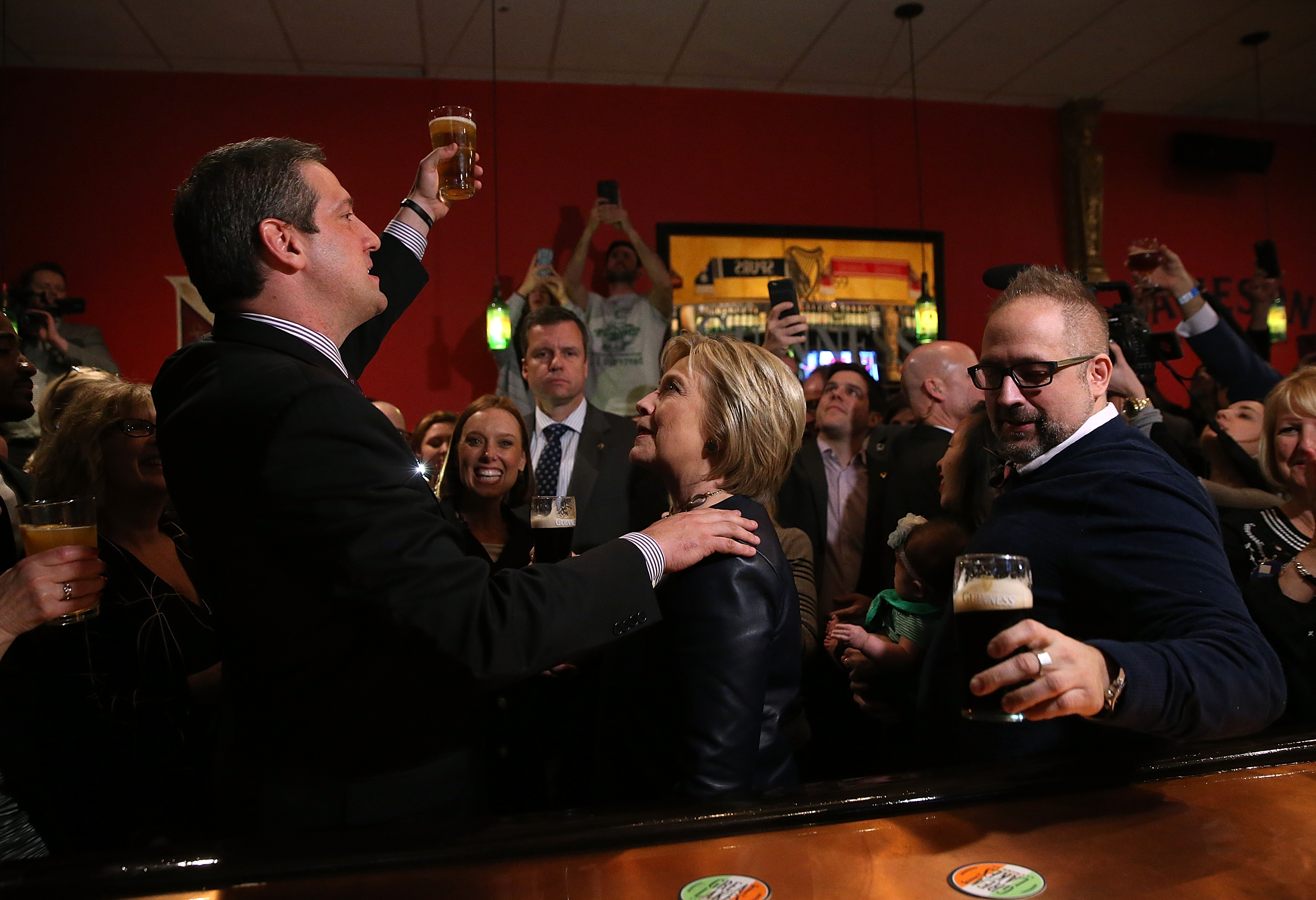 Rep Tim Ryan toasts former Secretary of State and Democratic presidential candidate Hillary Clinton has a Guiness beer at O'Donold's Irish Pub and Grill on March 12, 2016 in Youngstown, Ohio. (Photo by Justin Sullivan/Getty Images)