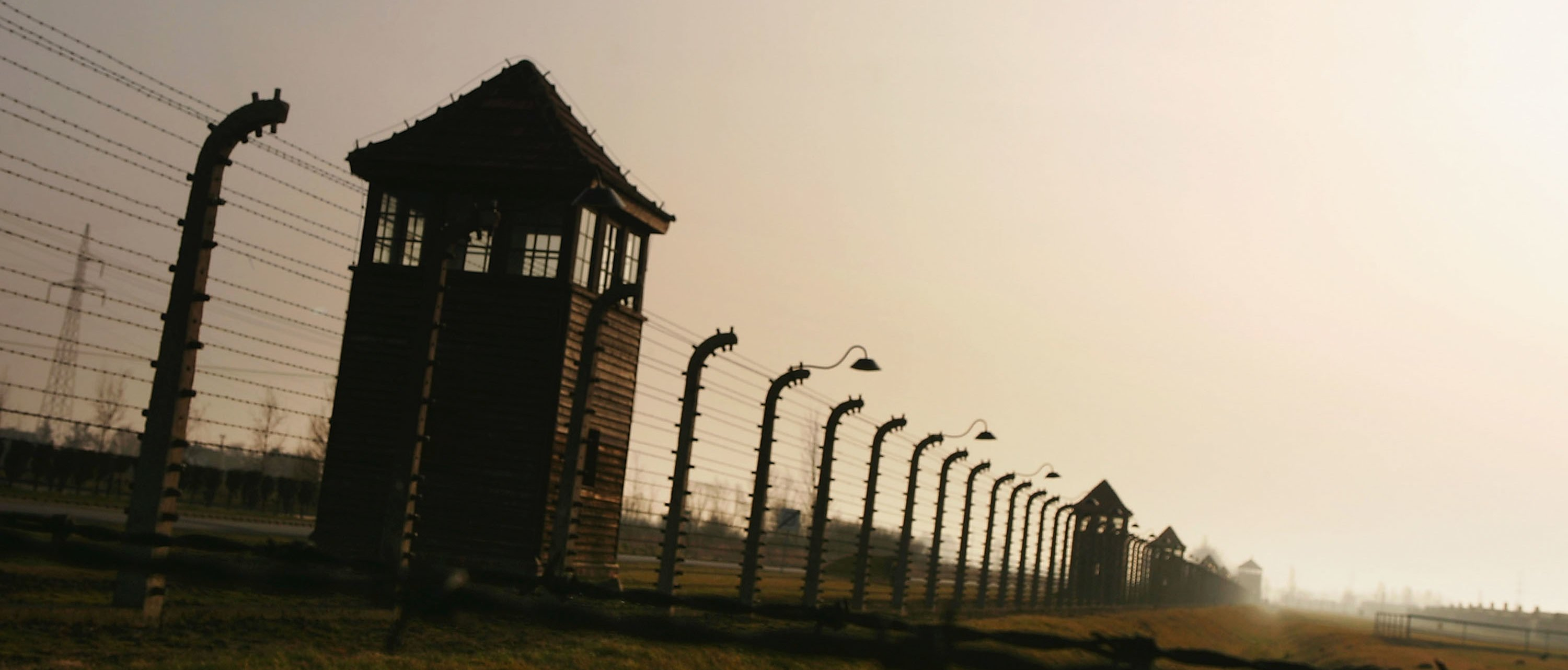 BREZEZINKA, POLAND - DECEMBER 10: Watch towers surrounded by mulitiple high voltage fences, December 10, 2004 at Auschwitz II - Birkenau which was built in March 1942 in the village of Brzezinka, Poland. The camp was liberated by the Soviet army on January 27, 1945, January 2005 will be the 60th anniversary of the liberation of the extermination and concentration camps, when survivors and victims who suffered as a result of the Holocaust will commemorated across the world. (Photo by Scott Barbour/Getty Images)