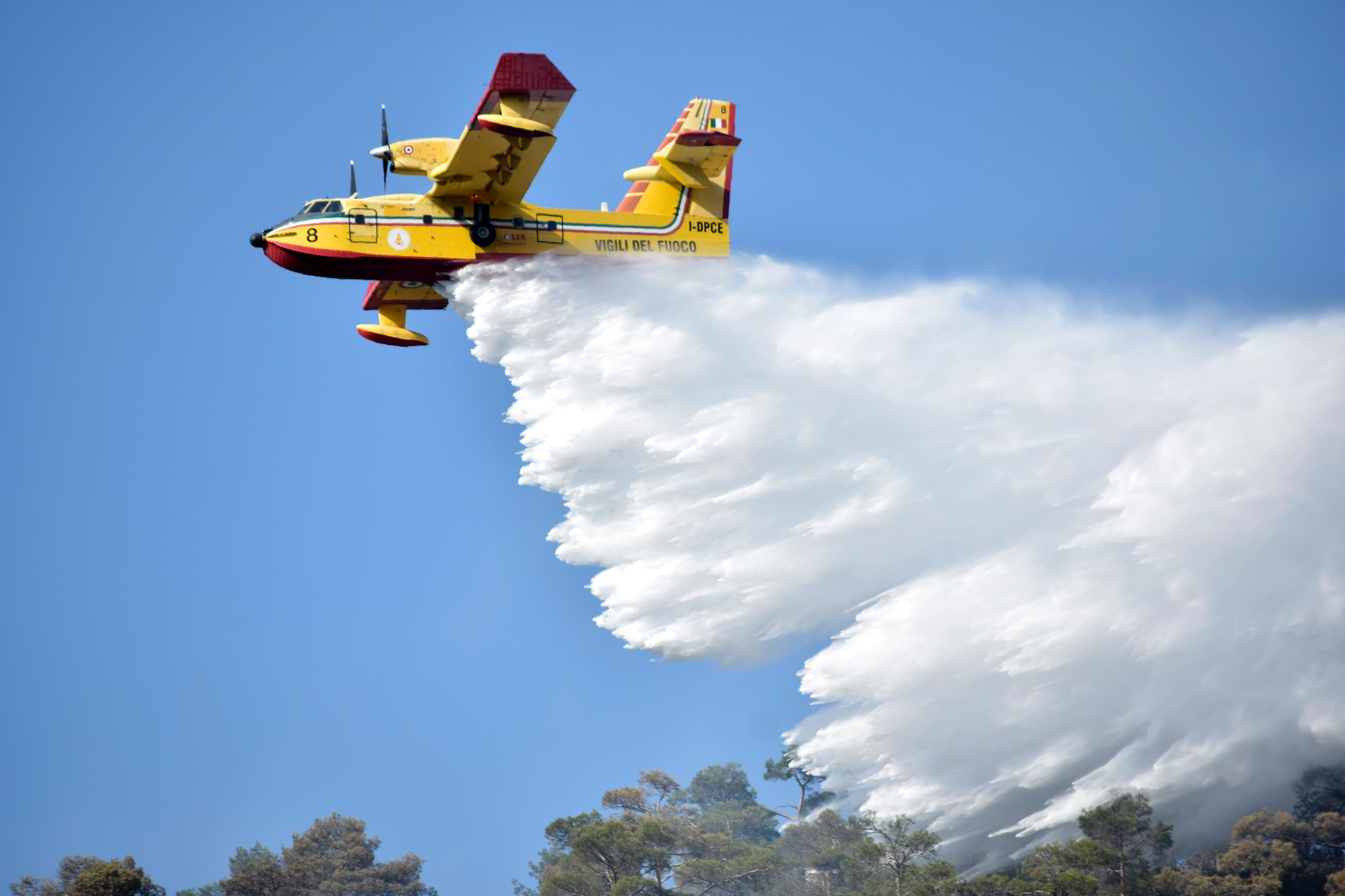 A firefighting plane, coming from Italy to assist local teams, drops water above the Cypriot village of Evrychou in the Troodos mountain area on June 22, 2016 during a forest fire. (GEORGIO PAPAPETROU/AFP/Getty Images)