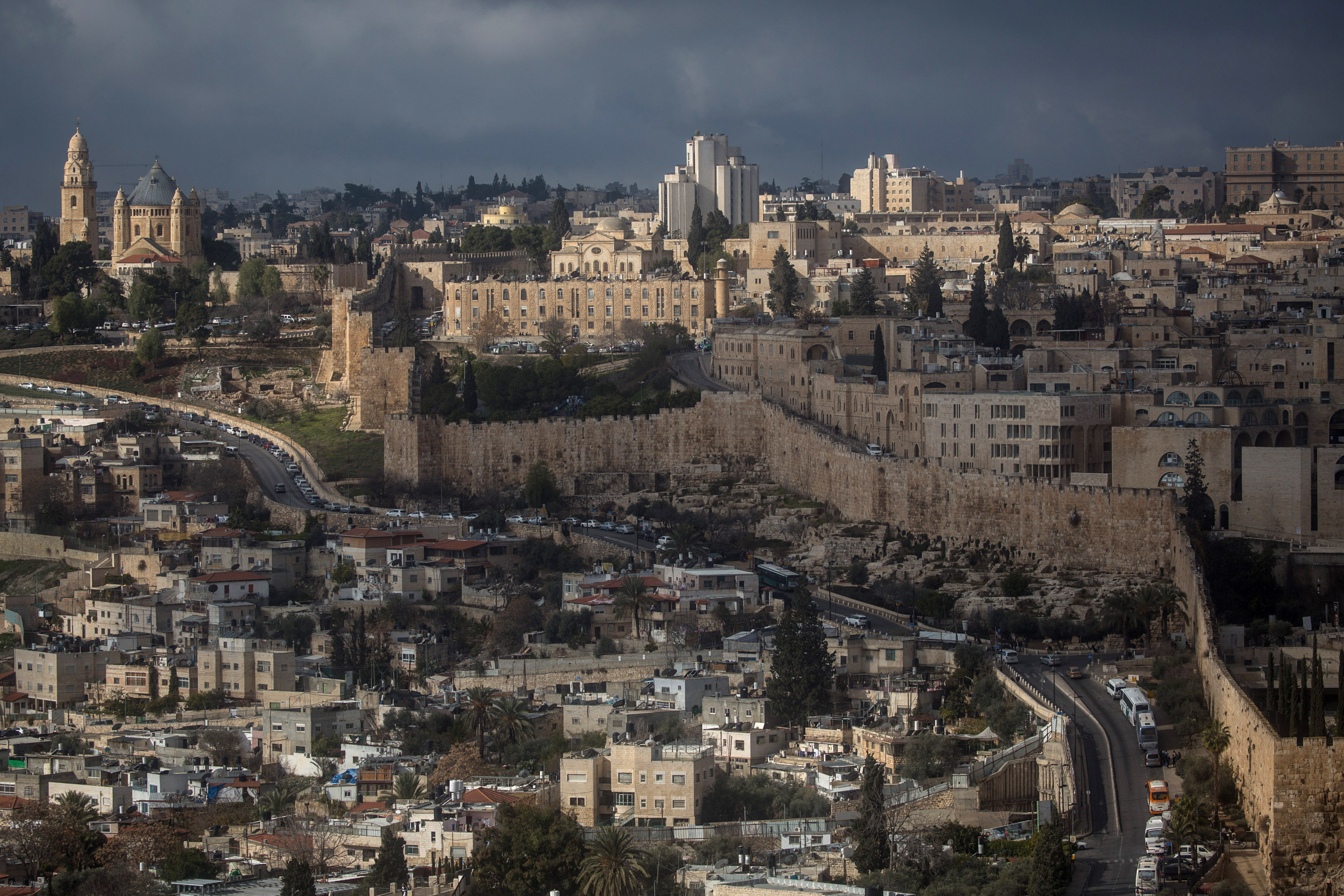JERUSALEM, ISRAEL - JANUARY 13: The Old City is seen from the Mount of Olives on January 13, 2017 in Jerusalem, Israel. 70 countries attended the recent Paris Peace Summit and called on Israel and Palestinians to resume negotiations that would lead to a two-state solution, however the recent proposal by U.S President-elect Donald Trump to move the US embassy from Tel Aviv to Jerusalem and last month's U.N. Security Council resolution condemning Jewish settlement activity in the West Bank have contributed to continued uncertainty across the region. The ancient city of Jerusalem where Jews, Christians and Muslims have lived side by side for thousands of years and is home to the Al Aqsa Mosque compound or for Jews The Temple Mount, continues to be a focus as both Israelis and Palestinians claim the city as their capital. The Israeli-Palestinian conflict has continued since 1947 when Resolution 181 was passed by the United Nations, dividing Palestinian territories into Jewish and Arab states. The Israeli settlement program has continued to cause tension as new settlements continue to encroach on land within the Palestinian territories. The remaining Palestinian territory is made up of the West Bank and the Gaza strip. (Photo by Chris McGrath/Getty Images)