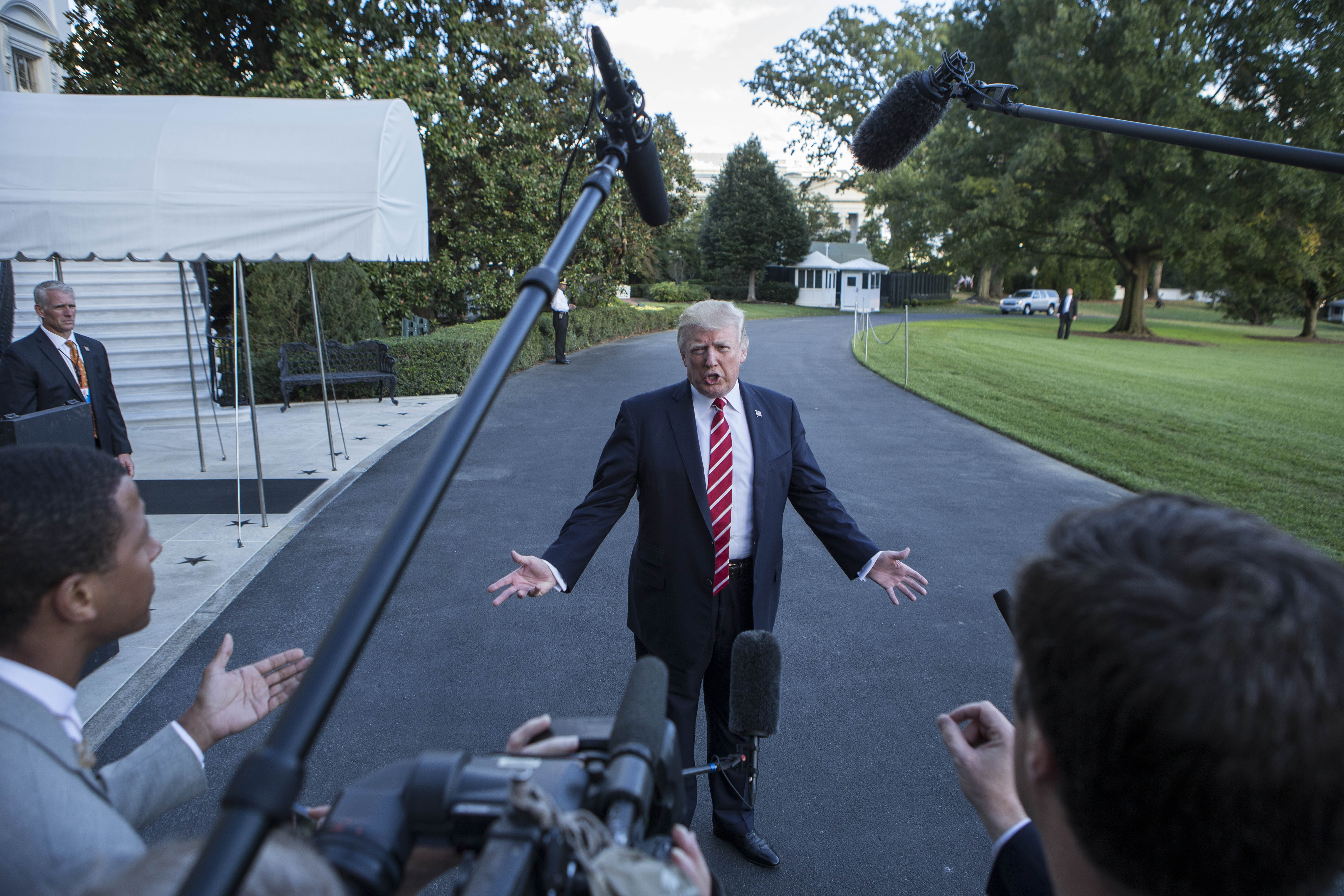 US President Donald Trump speaks with reporters outside the White House prior to his departure aboard Marine One on October 7, 2017. (ALEX EDELMAN/AFP/Getty Images)