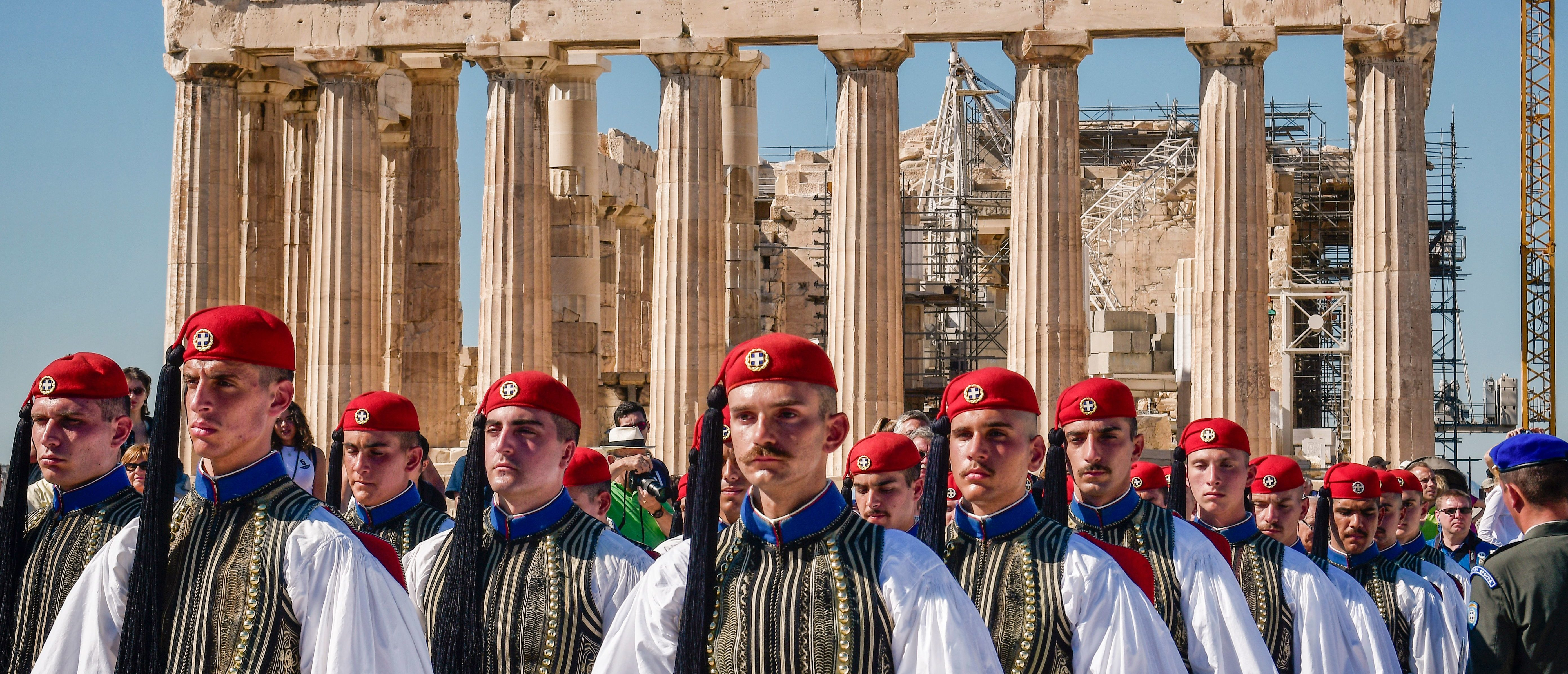 Greek presidental Evzoni Guards stand in front the Parthenon temple atop the Acropolis hill during a ceremony marking the anniversary of the liberation of Athens from Nazi occupation, on October 12, 2017 in Athens. LOUISA GOULIAMAKI/AFP/Getty Images)