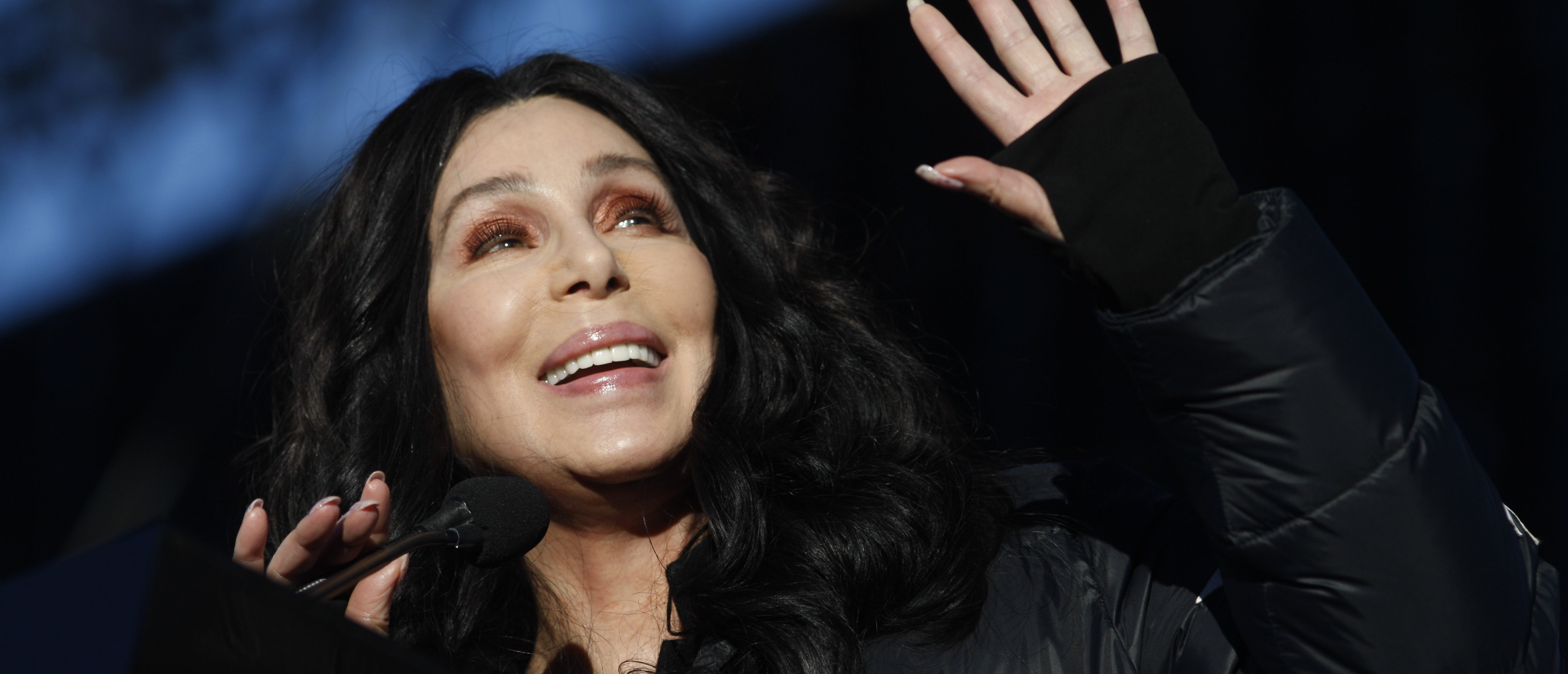 """LAS VEGAS, NV - JANUARY 21: Singer/actress Cher speaks during the Women's March """"Power to the Polls"""" voter registration tour launch at Sam Boyd Stadium on January 21, 2018, in Las Vegas, Nevada. Demonstrators across the nation gathered over the weekend, one year after the historic Women's March on Washington, D.C., to protest President Donald Trump's administration and to raise awareness for women's issues. (Photo by Sam Morris/Getty Images)"""