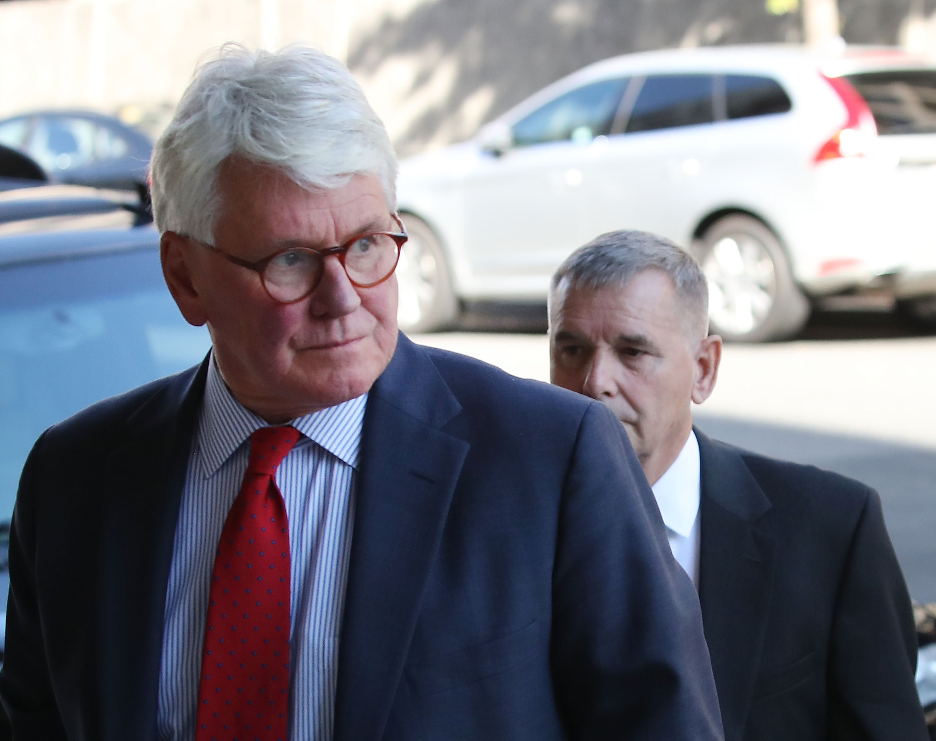 Retired Gen. James Cartwright, (R), arrives for a hearing with his attorney Greg Craig (L), at U.S. District Court, October 17, 2016. (Mark Wilson/Getty Images)
