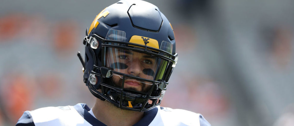 CHARLOTTE, NC - SEPTEMBER 01: Will Grier #7 of the West Virginia Mountaineers warms up before their game against the Tennessee Volunteers at Bank of America Stadium on September 1, 2018 in Charlotte, North Carolina. (Photo by Streeter Lecka/Getty Images)