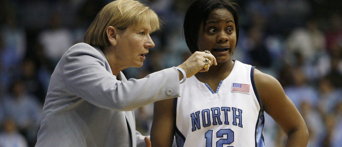 University of North Carolina head coach Sylvia Hatchell (L) exchanges words with North Carolina player Ivory Latta during the team's loss to Duke University in their NCAA basketball game in Chapel Hill, North Carolina February 8, 2007. REUTERS/Ellen Ozier