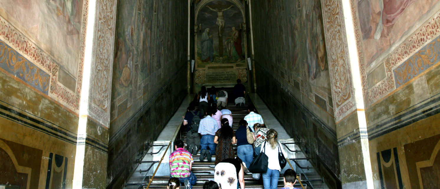 ROME, ITALY - JUNE 13: Pilgrims pray and visit in front of restored frescos of the Scala Sancta (Holy Stairs) on June 13, 2007 in Rome, Italy. The restoration has been co-ordinated jointly by the Los Angeles-based Getty Foundation, Rome's provincial authorities and the Selex Communications Company. (Photo by Franco Origlia/Getty Images)