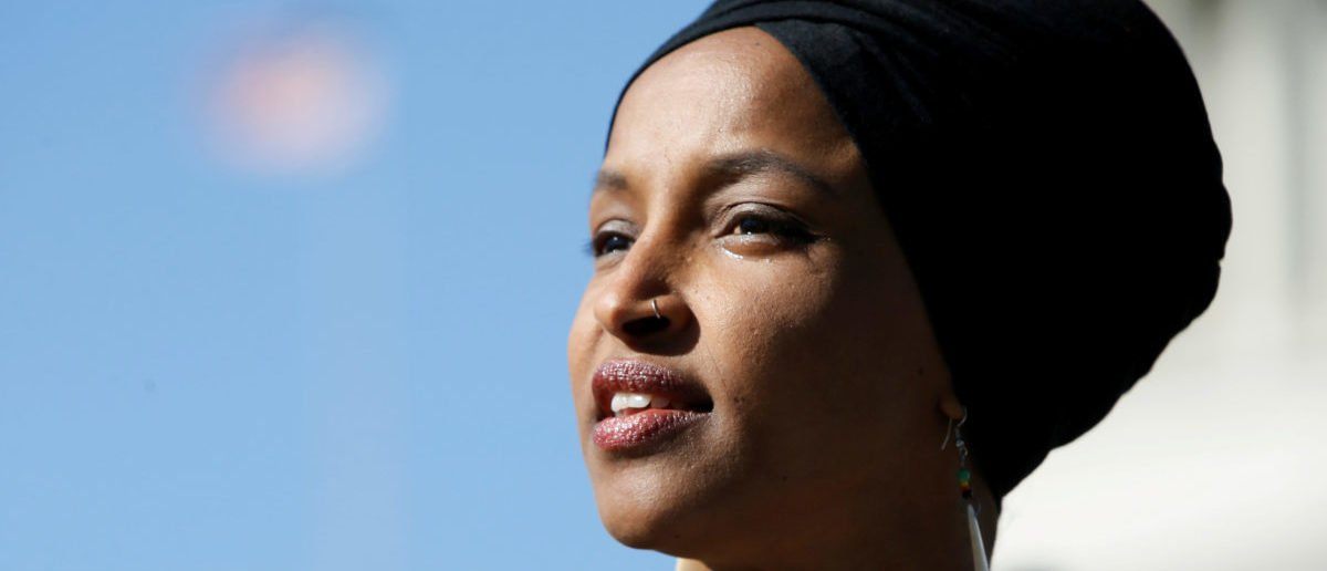 """Rep. Ilhan Omar speaks about Trump administration policies toward Muslim immigrants and her own immigrant background at a news conference by members of the U.S. Congress """"to announce legislation to repeal President Trumps existing executive order blocking travel from majority Muslim countries"""" outside the U.S. Capitol in Washington, U.S., April 10, 2019. REUTERS/Jim Bourg/File Photo"""
