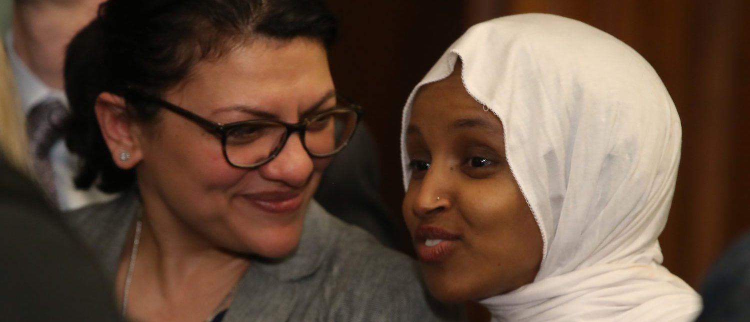 Rep. Ilhan Oma (R) and Rep. Rashida Tlaib attend a news conference where House and Senate Democrats introduced the Equality Act of 2019 which would ban discrimination against lesbian, gay, bisexual and transgender people, on March 13, 2019 in Washington, D.C. (Photo by Mark Wilson/Getty Images)