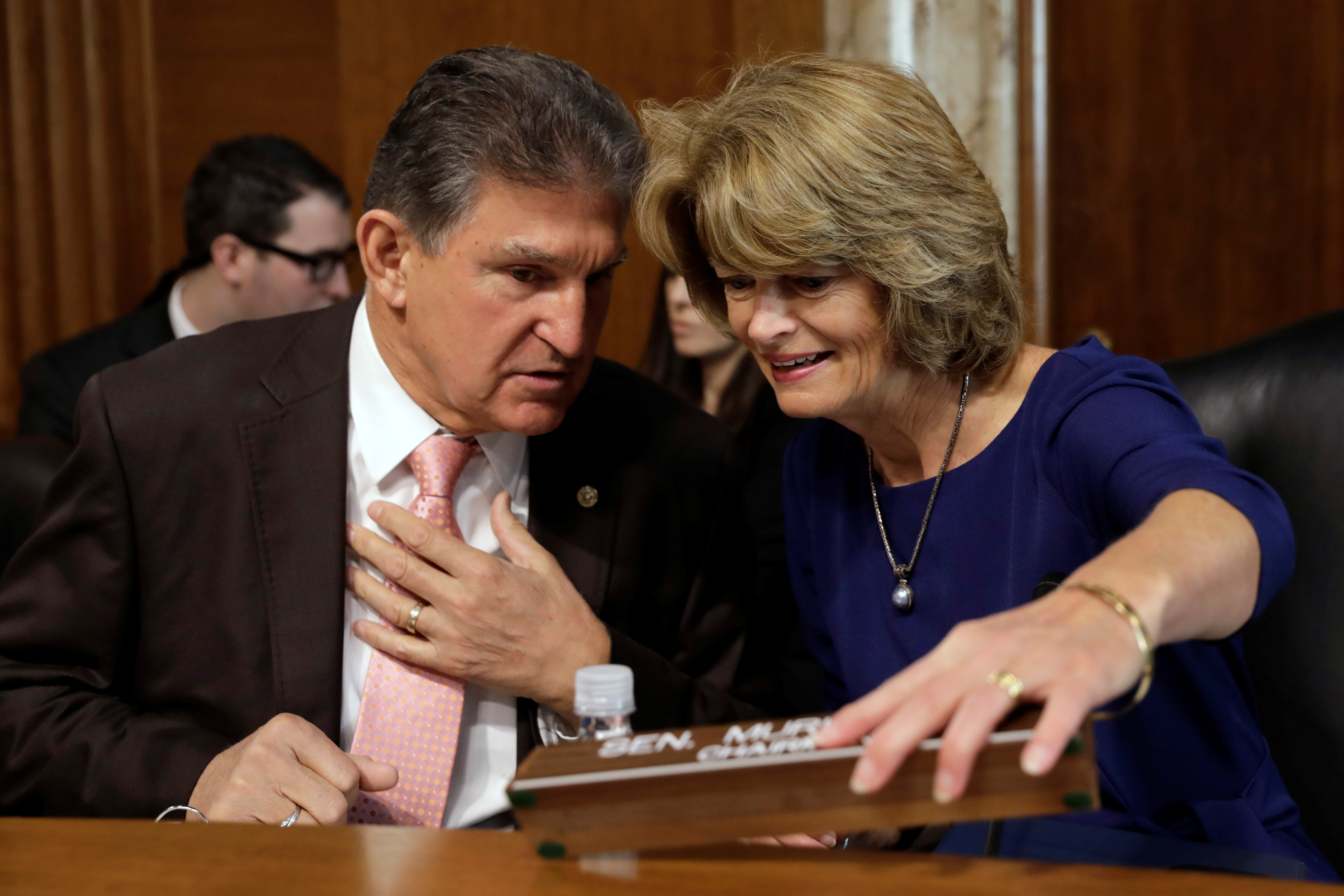 Senators Joe Manchin (D-WV) and Lisa Murkowski (R-AK) chat before a Senate Energy and Natural Resources Committee nomination hearing for former energy lobbyist David Bernhardt to be Interior secretary on Capitol Hill in Washington, U.S., March 28, 2019. REUTERS/Yuri Gripas