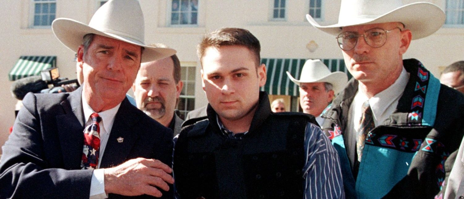 """John William """"Bill"""" King (C) is led from the Jasper County Courthouse by deputies following the first day of jury selection in his murder trial on January 25, 1999. (Paul Buck/AFP/Getty Images)"""
