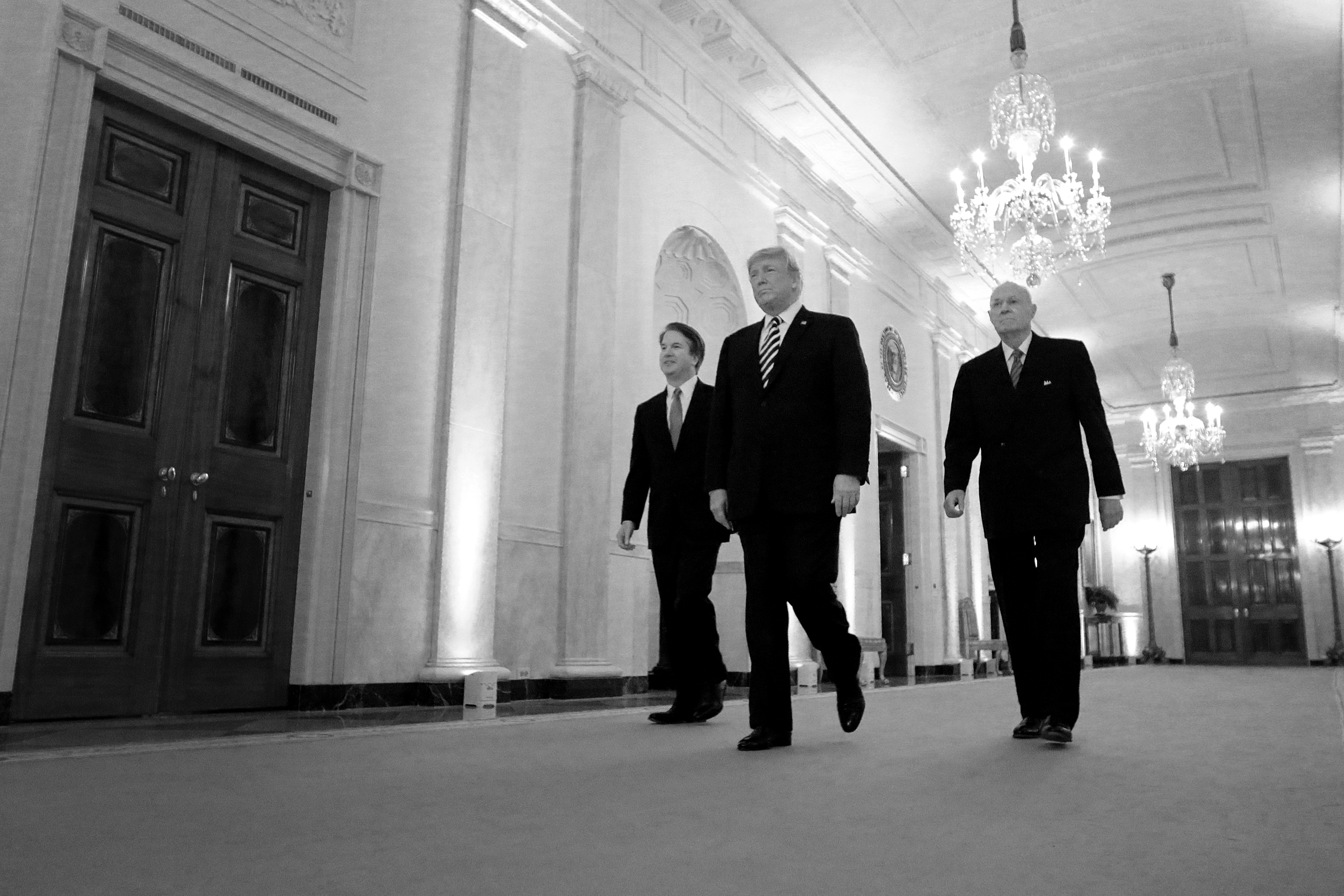 (L-R) Supreme Court Justice Brett Kavanaugh, President Donald Trump and retired Justice Anthony Kennedy walk into the East Room of the White House for Kavanaugh's ceremonial swearing on October 08, 2018. (Chip Somodevilla/Getty Images)