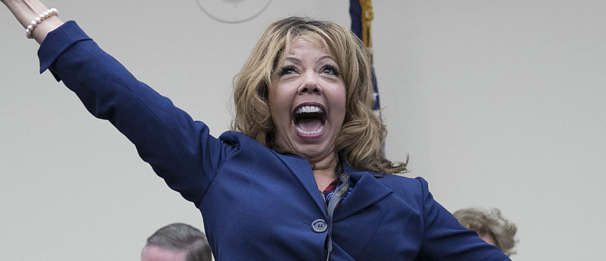 WASHINGTON, DC - NOVEMBER 30: Rep.-elect Lucy McBath (D-GA) celebrates after drawing the number 18 in the lottery draw for congressional offices November 30, 2018 in Washington, DC. As part of the new member orientation process, newly elected members of the U.S. House of Representatives take part in drawing random numbers that provide the order for selecting available congressional office space. (Photo by Win McNamee/Getty Images)
