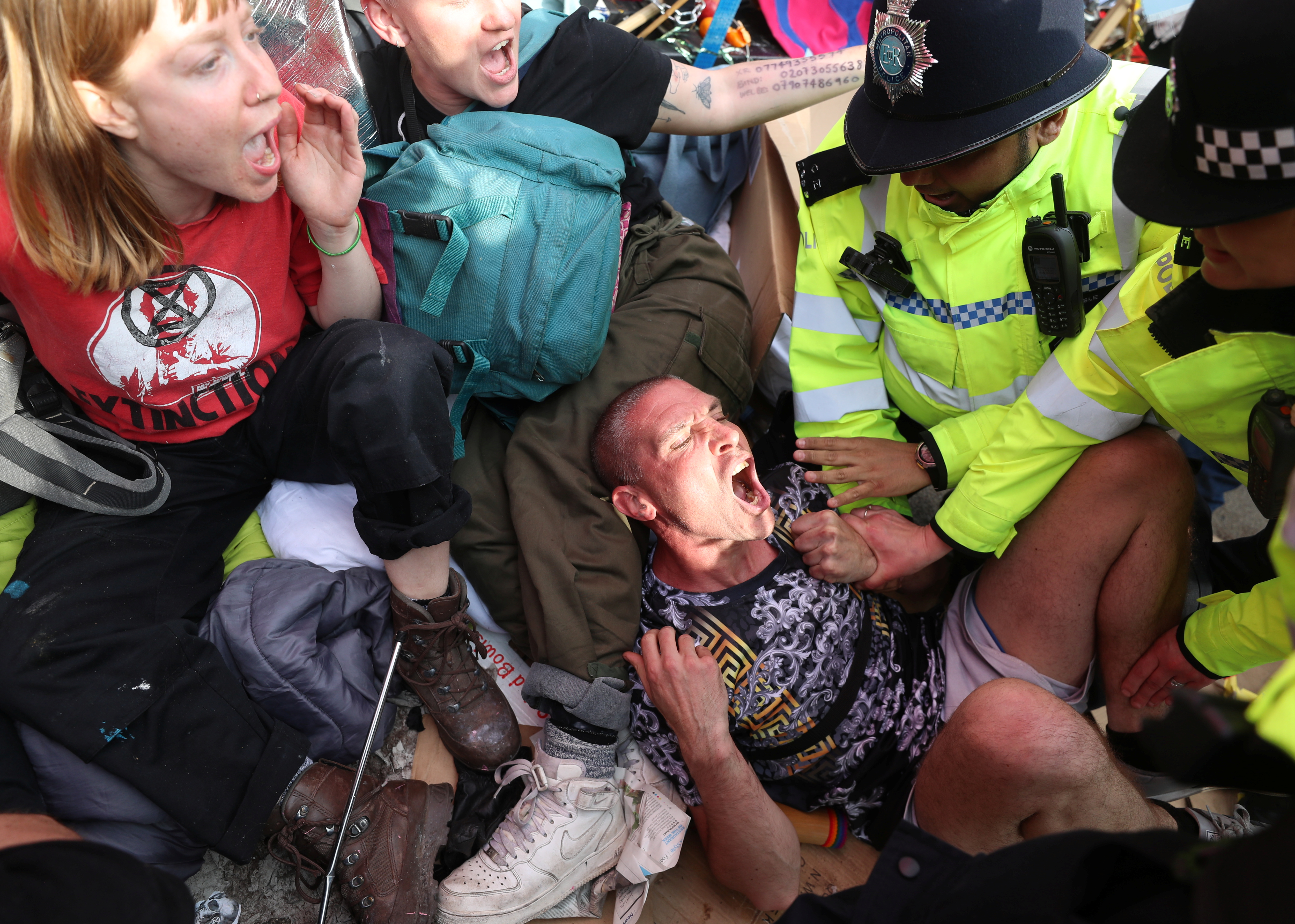 Police officers detain climate change activists at Oxford Circus during the Extinction Rebellion protest in London, Britain April 18, 2019. REUTERS/Simon Dawson.