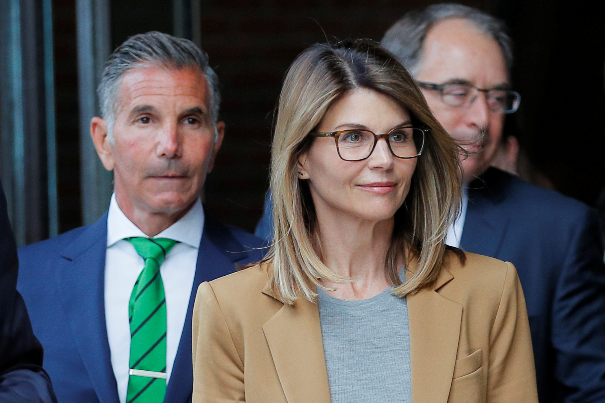 Actor Lori Loughlin, and her husband, fashion designer Mossimo Giannulli, leave the federal courthouse after facing charges in a nationwide college admissions cheating scheme, in Boston, Massachusetts, U.S., April 3, 2019. REUTERS/Brian Snyder