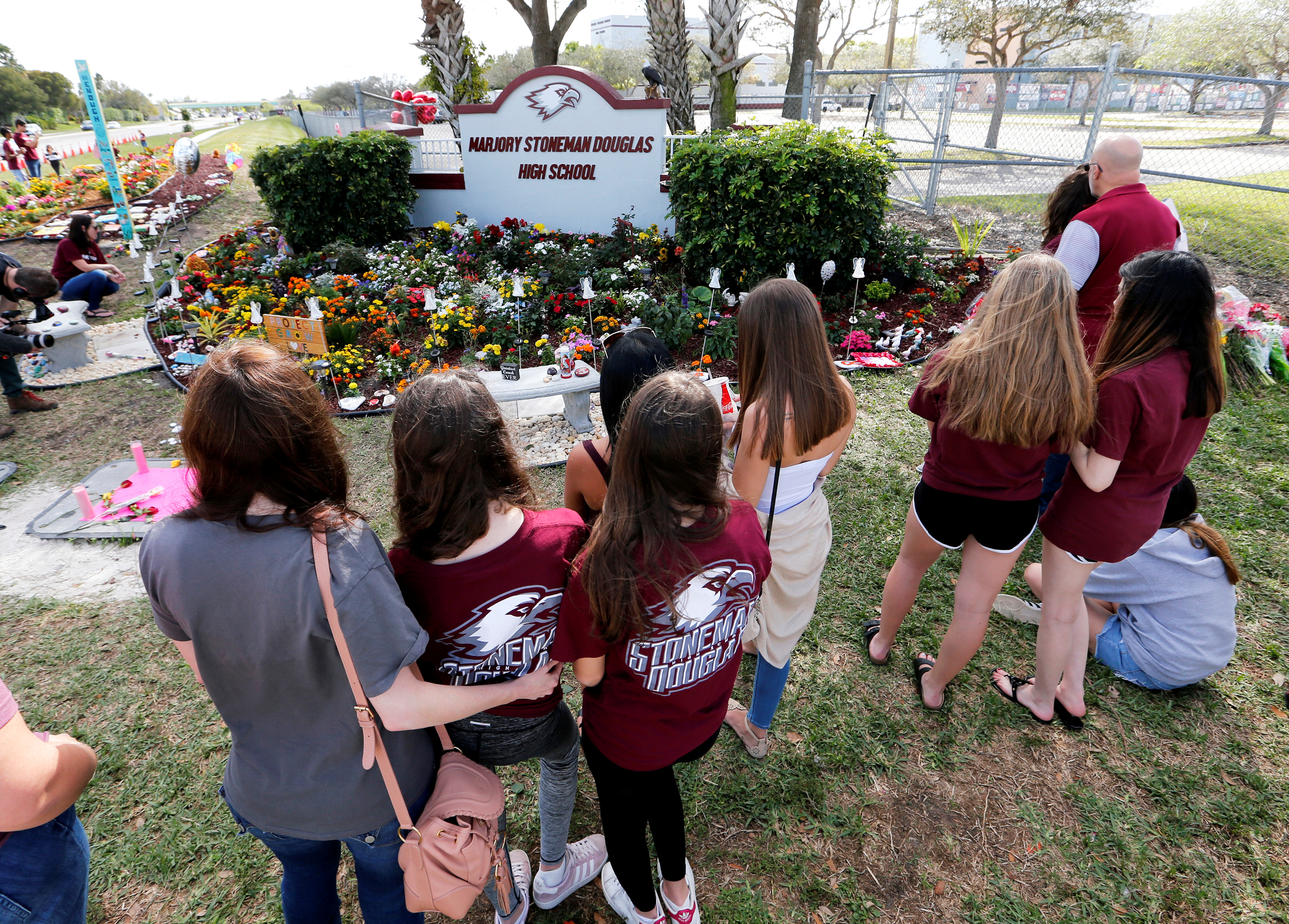 A memorial is viewed by parents and students on campus at a memorial on the one year anniversary of the shooting which claimed 17 lives at Marjory Stoneman Douglas High School in Parkland, Florida, U.S., February 14, 2019. REUTERS/Joe Skipper