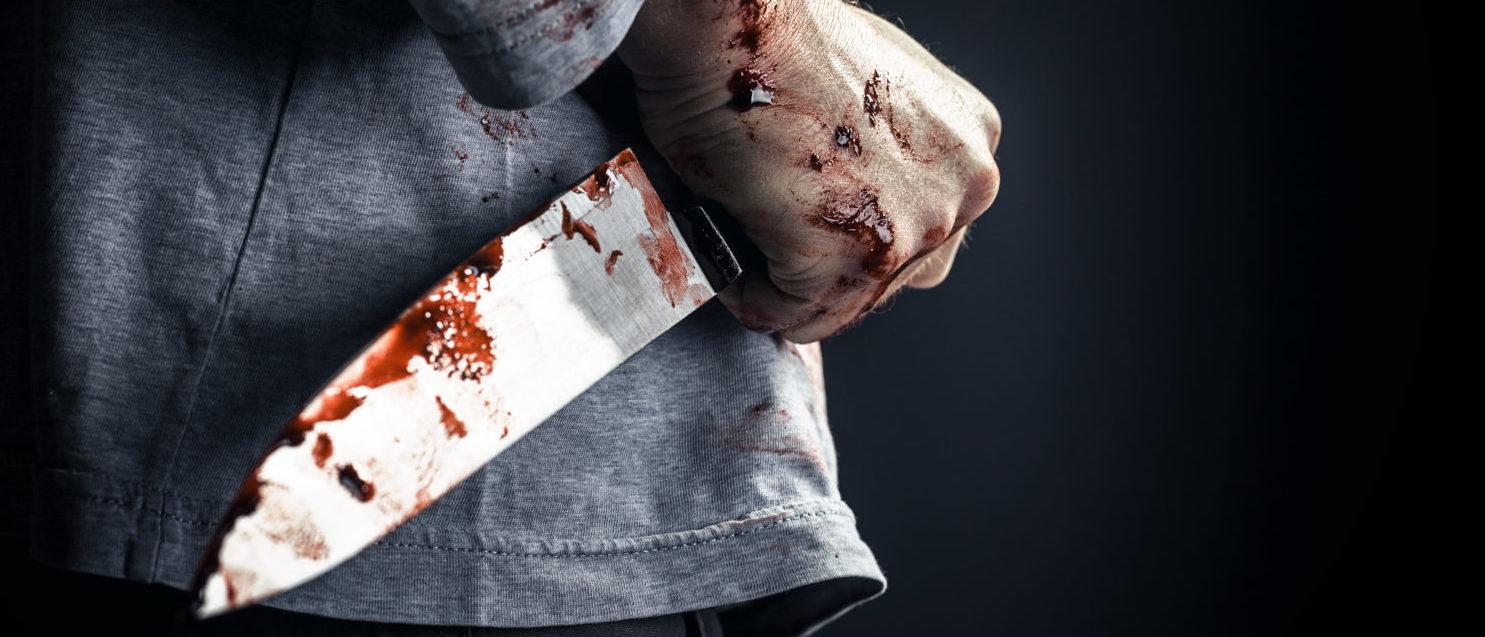 Man with a knife (Shutterstock/gualtiero boffi)