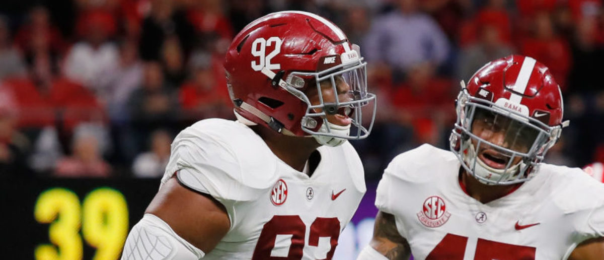 ATLANTA, GA - DECEMBER 01: Quinnen Williams #92 of the Alabama Crimson Tide reacts with Christian Miller #47 after sacking Jake Fromm #11 of the Georgia Bulldogs (not pictured) in the first half during the 2018 SEC Championship Game at Mercedes-Benz Stadium on December 1, 2018 in Atlanta, Georgia. (Photo by Kevin C. Cox/Getty Images)