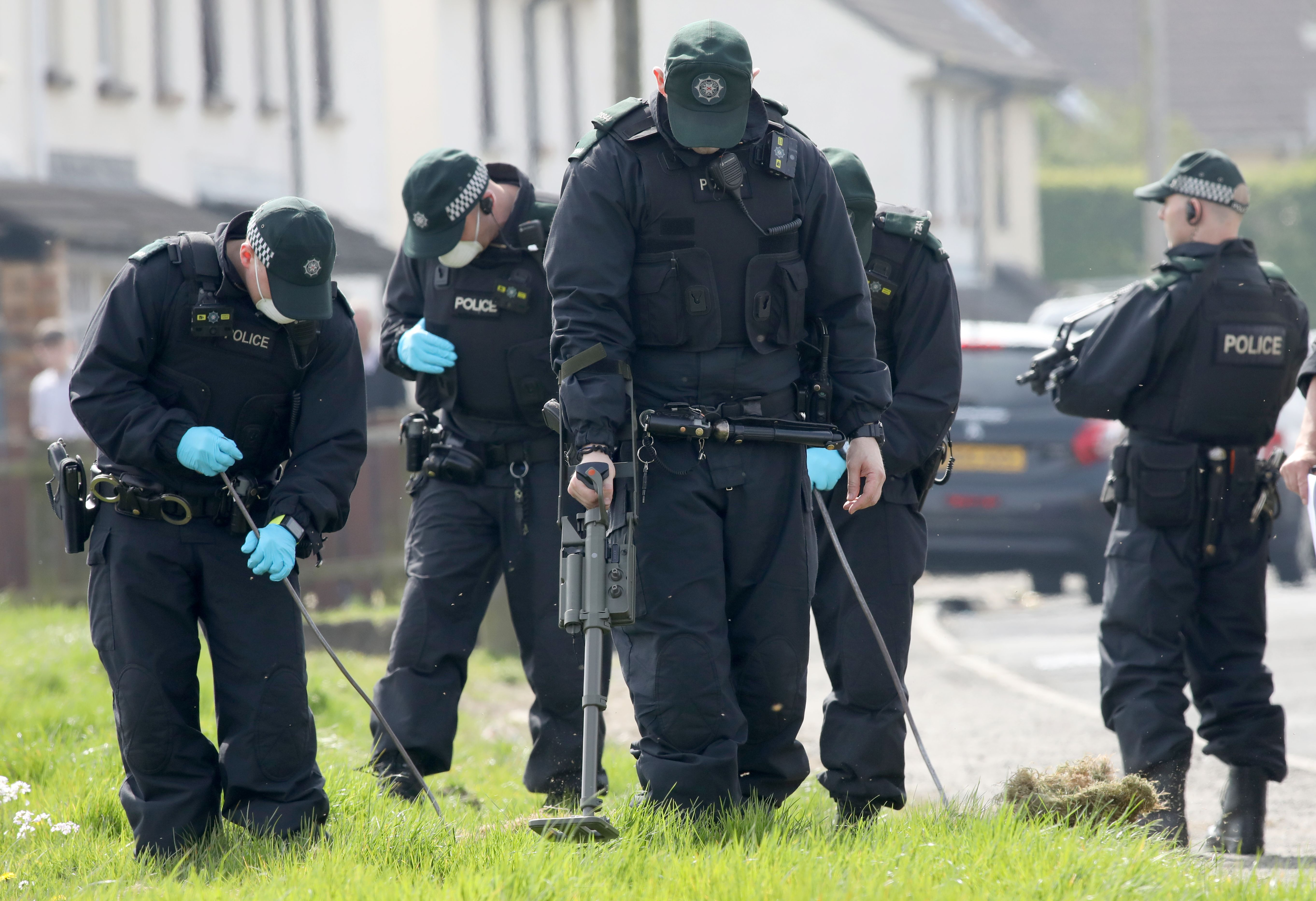 Police officers search waste ground near the scene in the Creggan area of Derry (Londonderry) in Northern Ireland on April 20, 2019 where journalist Lyra McKee was fatally shot amid rioting on April 18.(PAUL FAITH/AFP/Getty Images)
