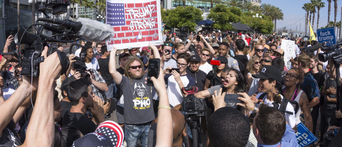 Huge groups of protesters clash with Trump supporters in a verbal exchange outside a Trump rally at the San Diego Convention Center (Shutterstock/Chad Zuber)