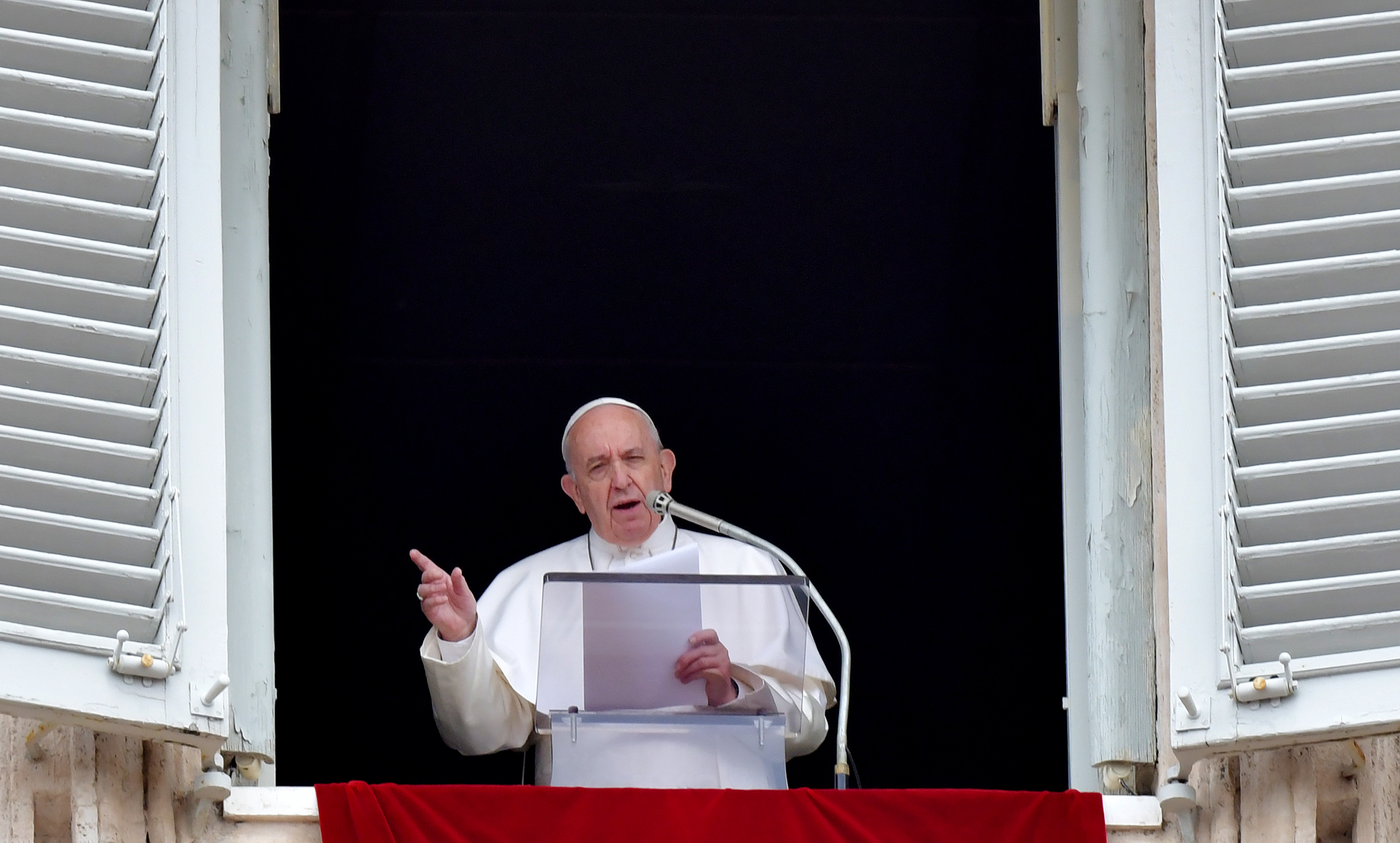 Pope Francis addresses the crowd from the window of the apostolic palace overlooking St Peter's square during the Regina Coeli prayer, on April 28, 2019 in Vatican. (TIZIANA FABI/AFP/Getty Images)