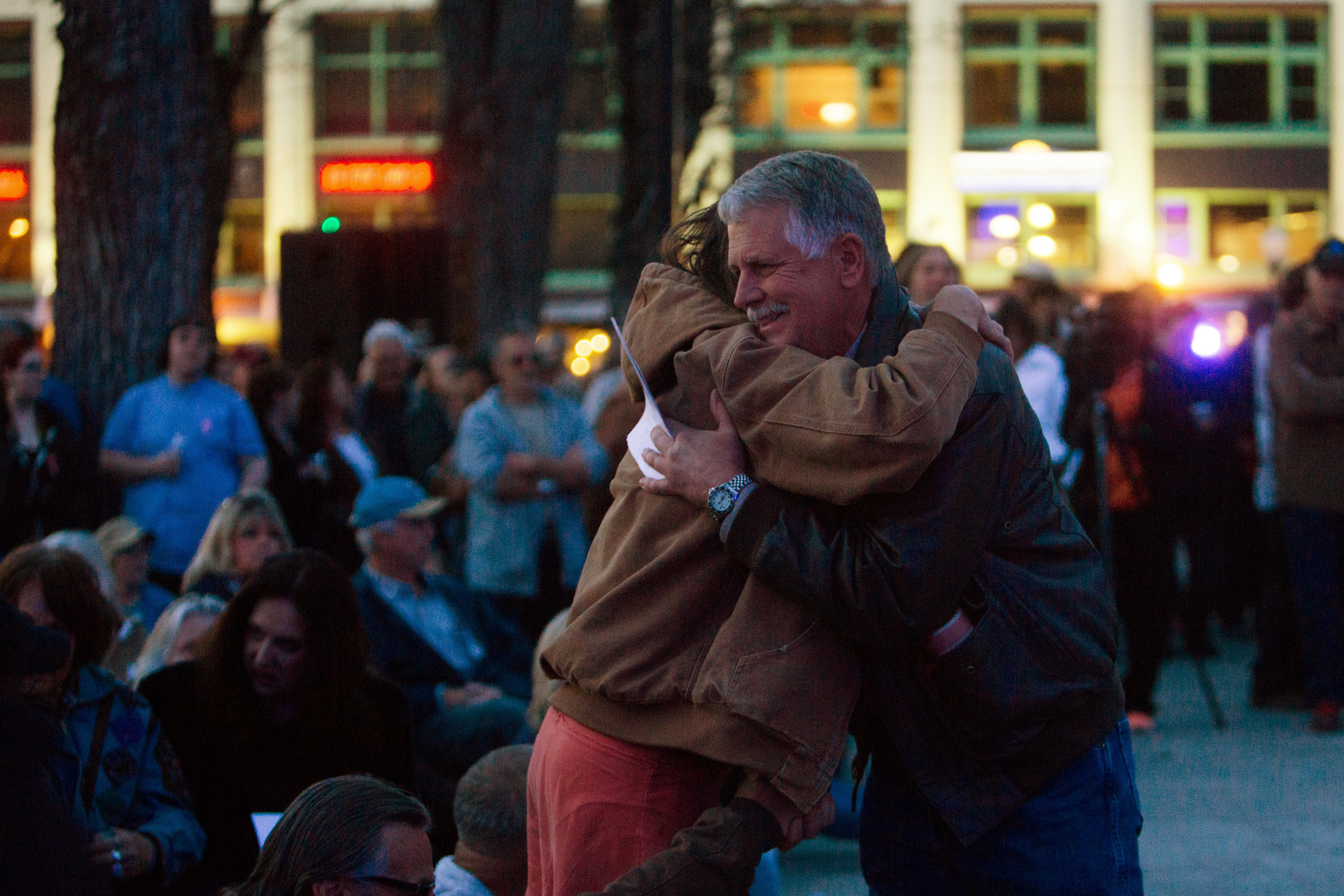 Carl Mueller is greeted by friends at a candlelight memorial honoring his daughter aid worker Kayla Mueller at the Prescott's Courthouse Square in Prescott, Arizona, February 18, 2015. REUTERS/Deanna Dent