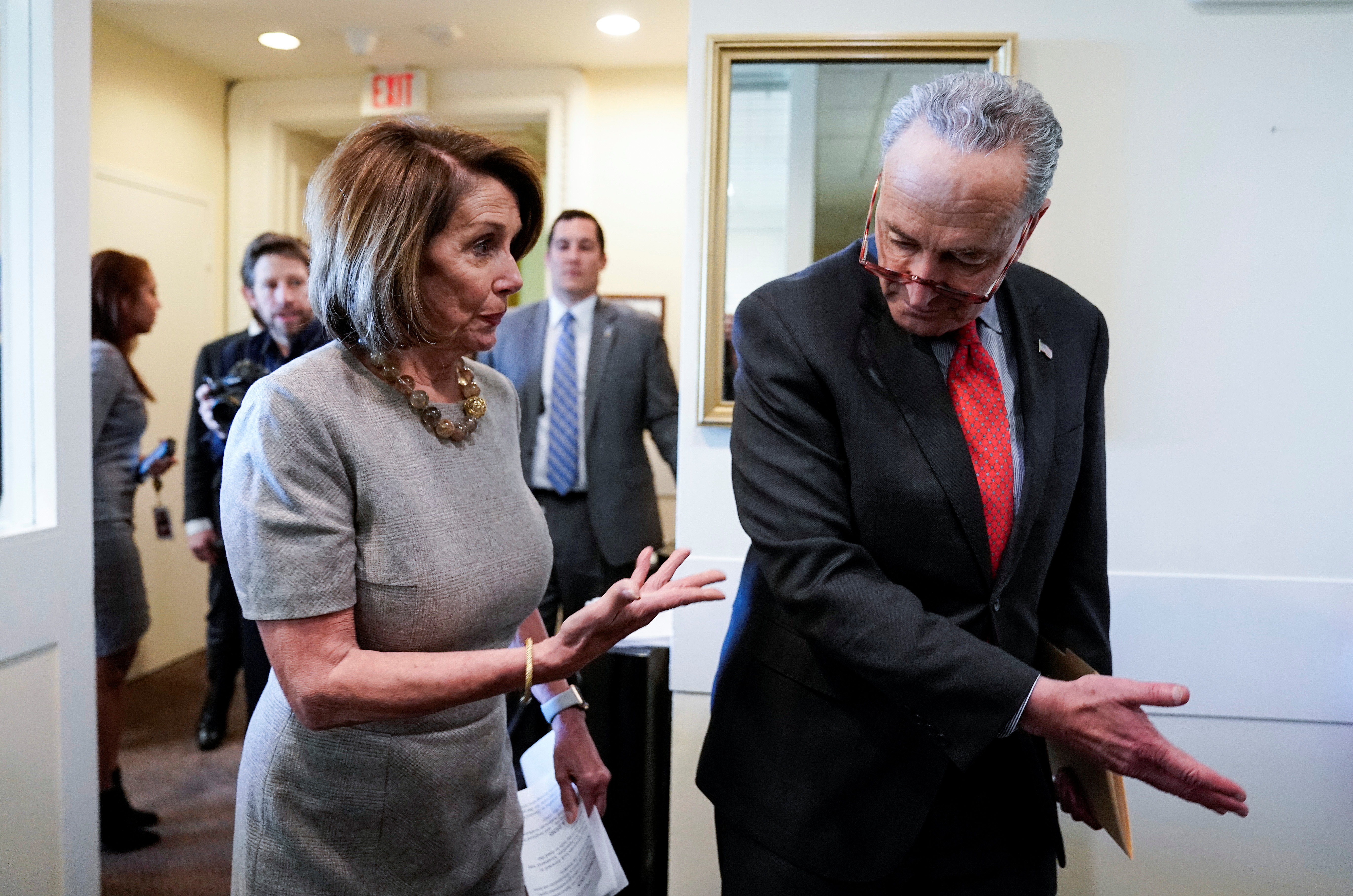 House Speaker Pelosi and Senate Minority Leader Schumer arrive to speak on Capitol Hill in Washington