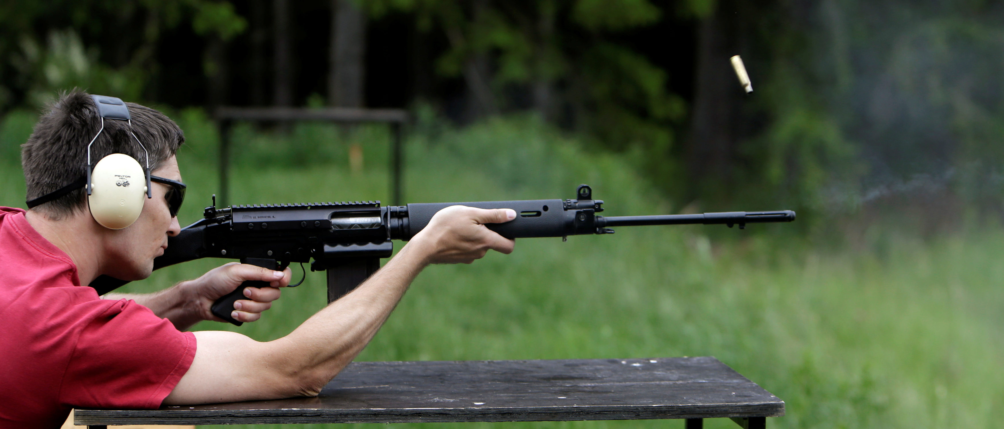 Jan Vurbs shoots his rifle at a forest shooting range near the village of Visnova, Czech Republic, June 9, 2016. REUTERS/David W Cerny