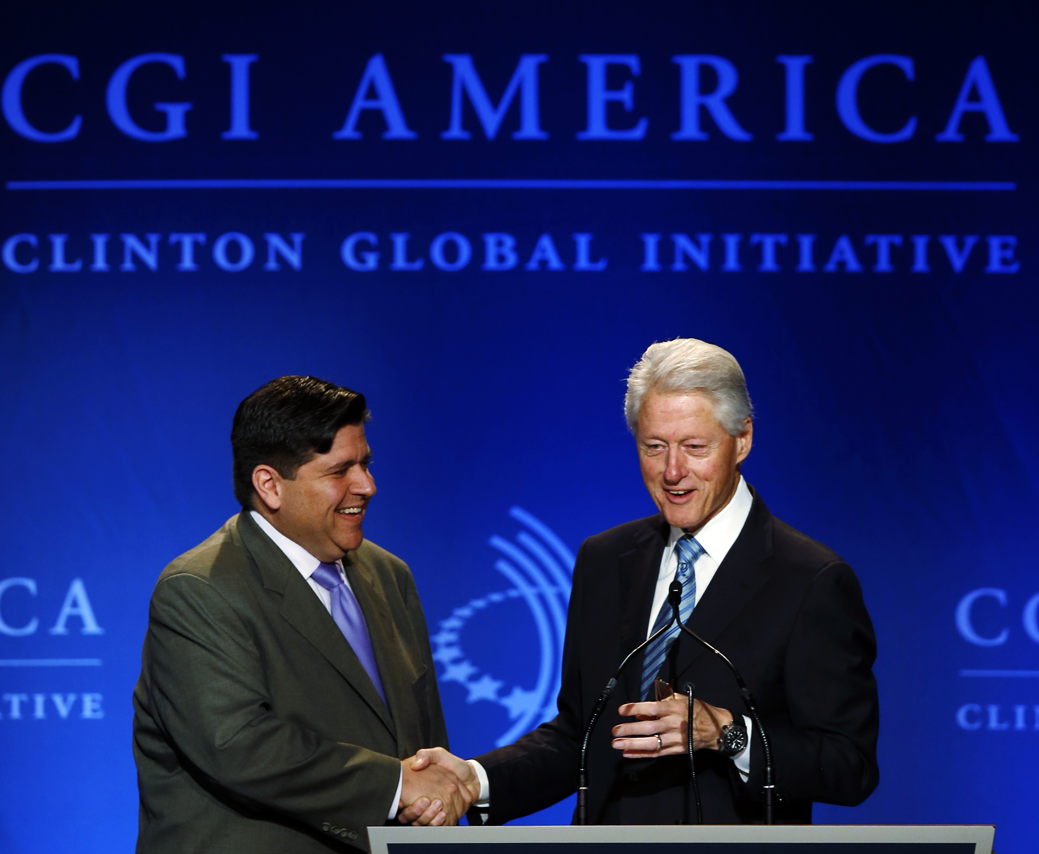 Former U.S. President Bill Clinton greets J.B. Pritzker, managing partner of The Pritzker Group, at the Clinton Global Initiative America meeting in Chicago, Illinois, June 13, 2013. REUTERS/Jim Young