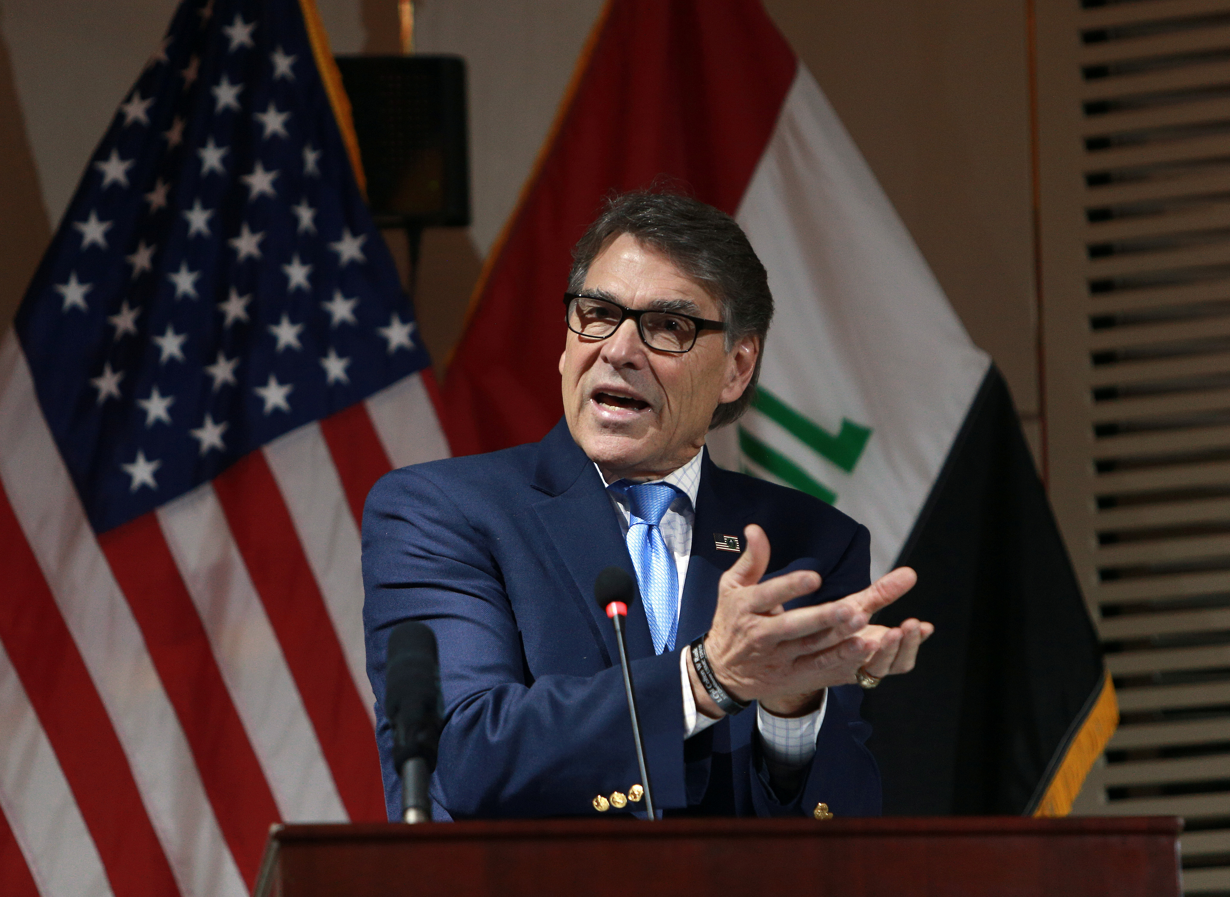 U.S. Energy Secretary Rick Perry gestures during a press conference in Baghdad