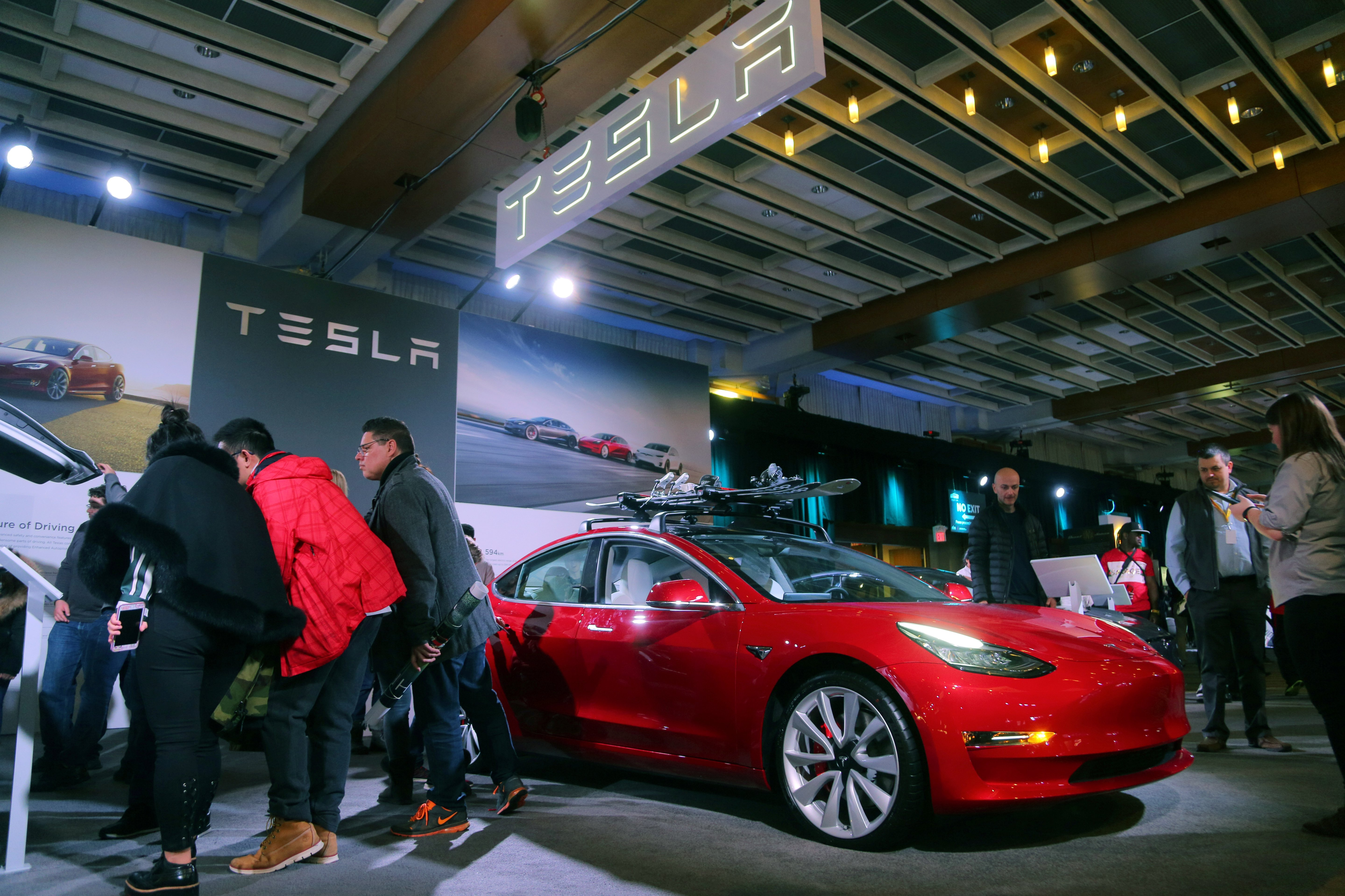 A Tesla Model 3 car is displayed at the Canadian International AutoShow in Toronto