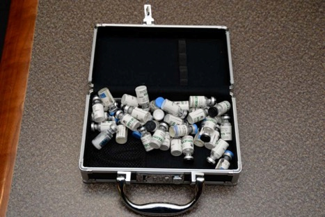 A locked case containing bottles of Tramodol uncovered by U.S. federal investigators in the home of U.S. Coast Guard lieutenant Christopher Paul Hasson in Silver Spring, Maryland, U.S., is shown in the photo provided February 20, 2019. U.S. Attorney's Office Maryland/Handout via REUTERS
