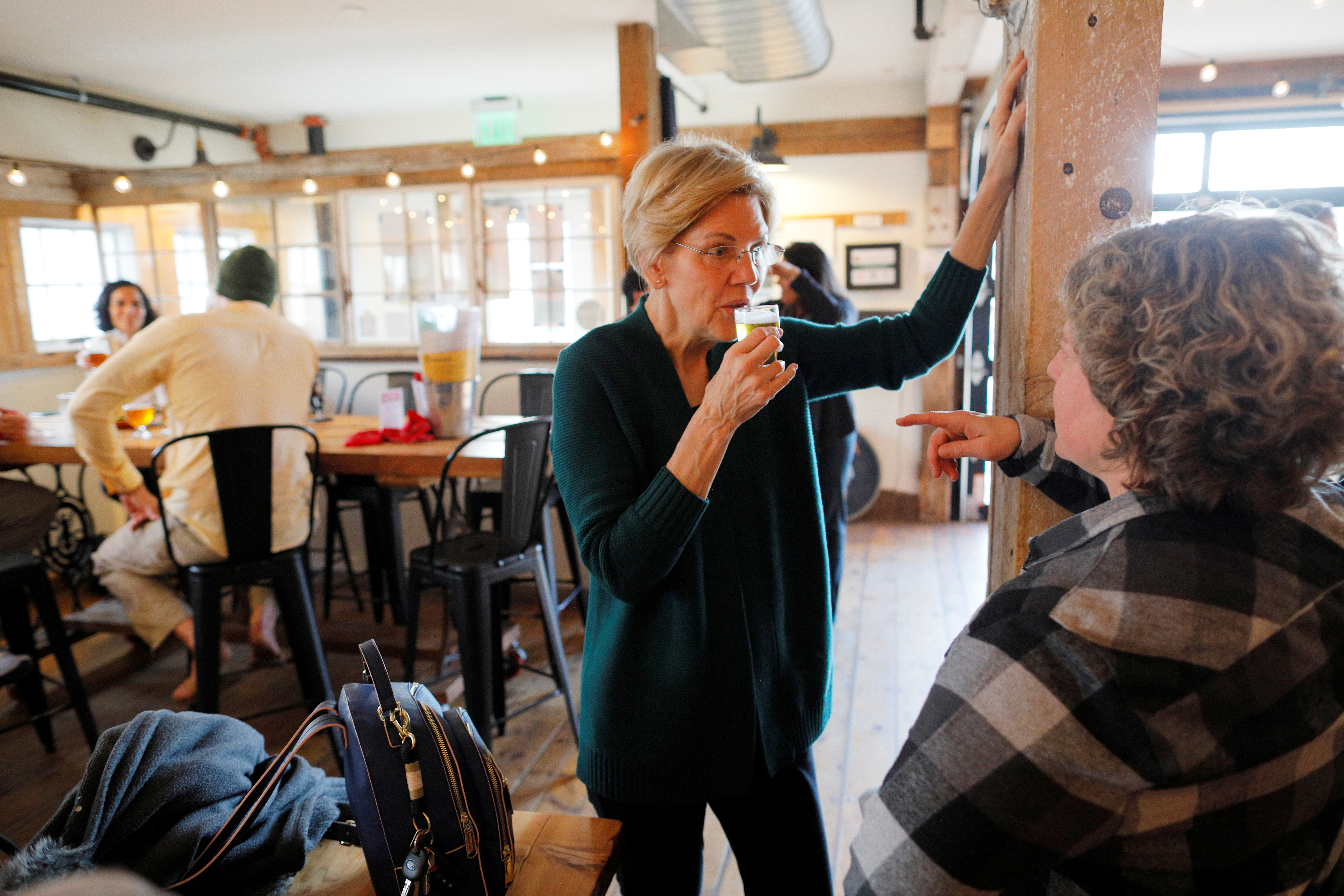Democratic 2020 U.S. presidential candidate Warren samples a beer in North Hampton