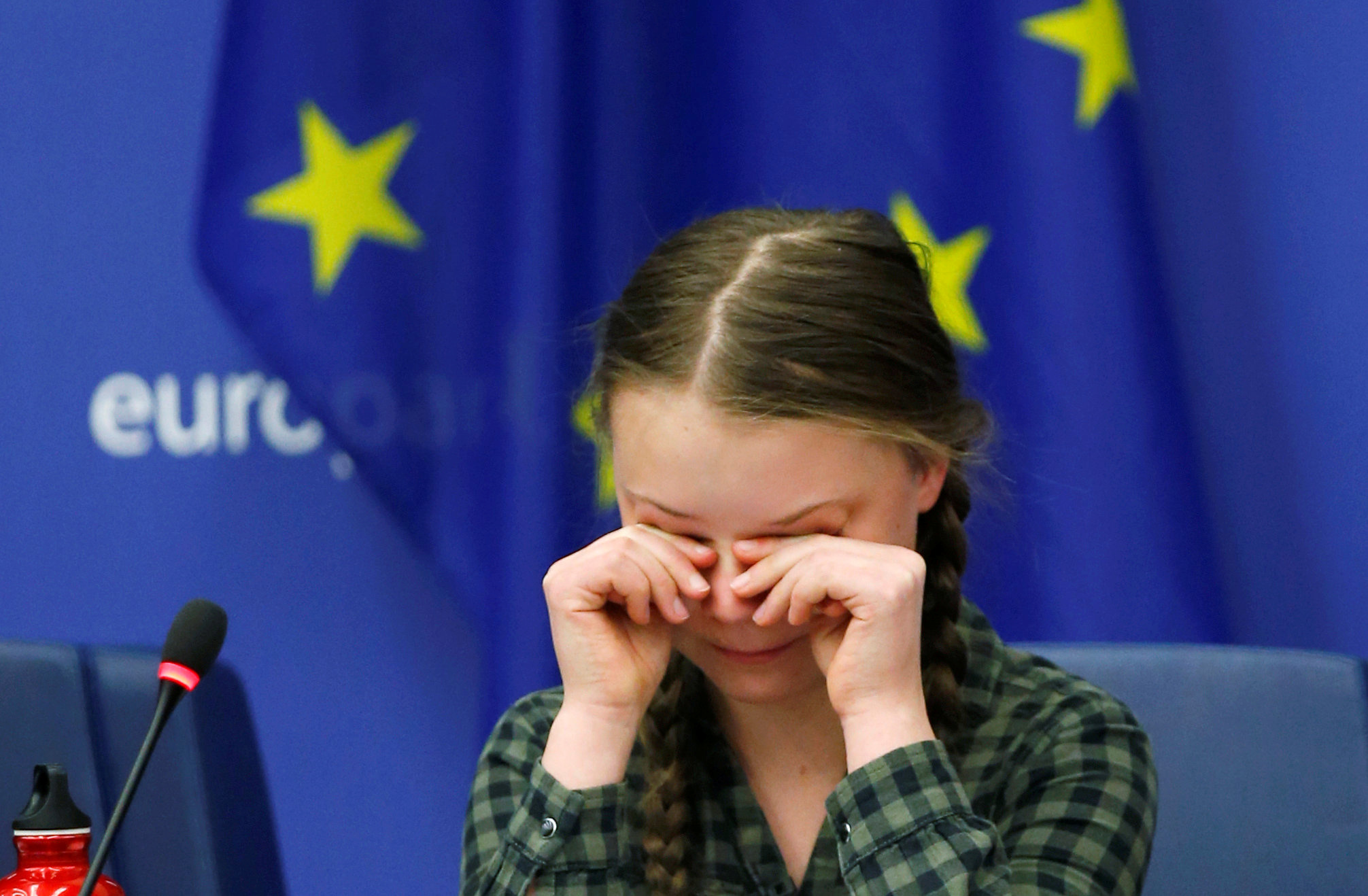 Swedish environmental activist Thunberg cries at the end of her speech to the environment committee of the European Parliament in Strasbourg