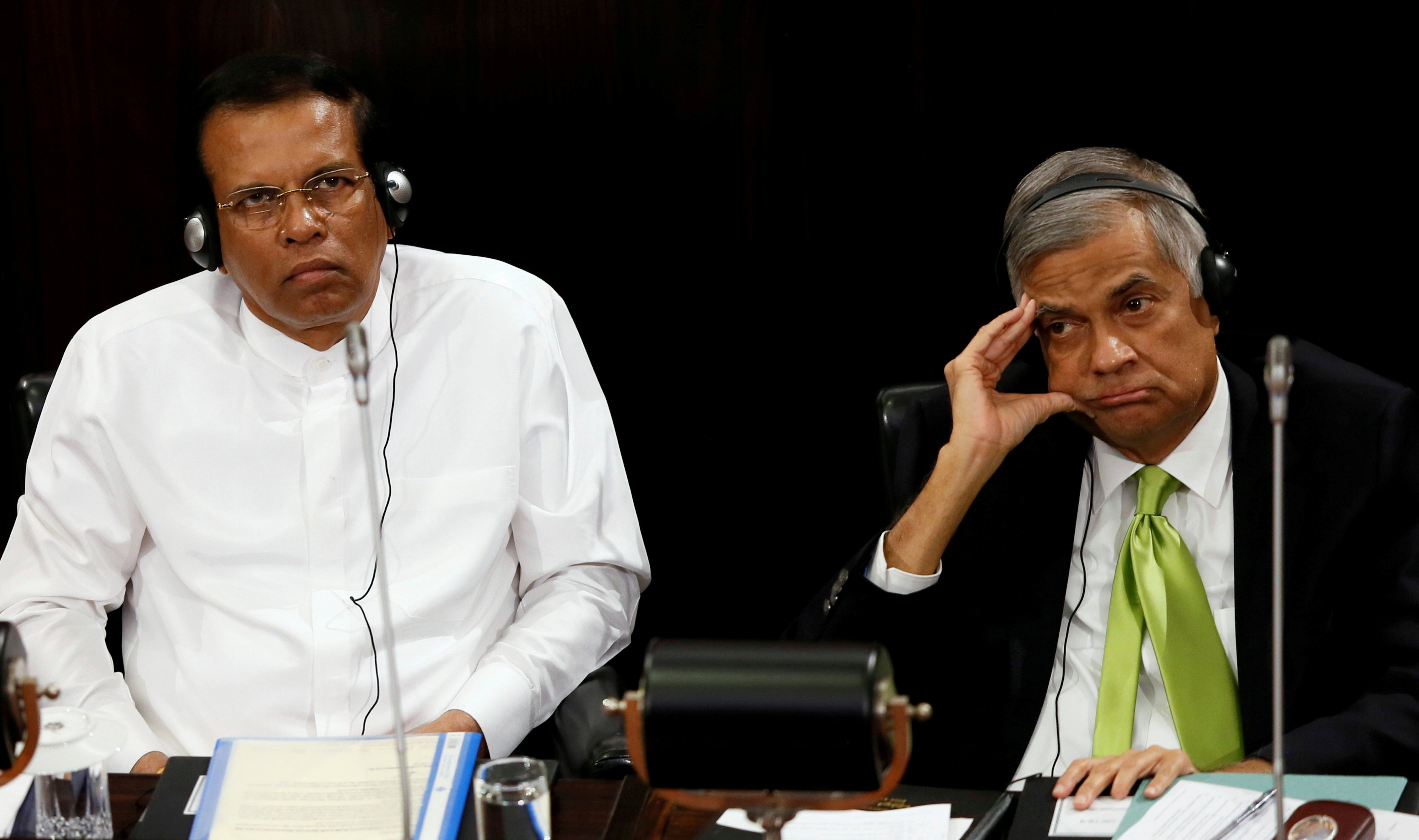 Sri Lanka's President Maithripala Sirisena and Prime Minister Ranil Wickremesinghe look on during a Parliament session marking the 70th anniversary of Sri LankaÕs Government, in Colombo, Sri Lanka October 3, 2017. REUTERS/Dinuka Liyanawatte/File Photo