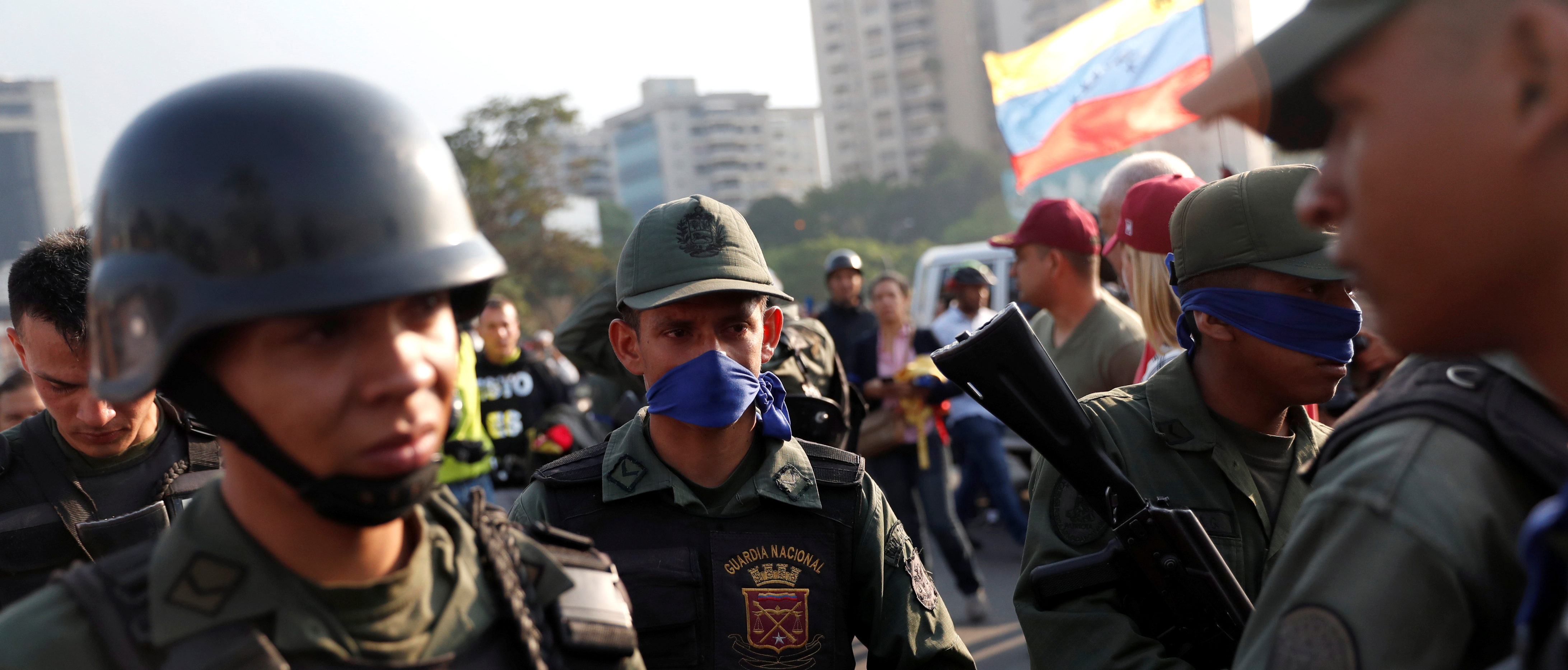 "Military members stand near the Generalisimo Francisco de Miranda Airbase ""La Carlota"", in Caracas, Venezuela April 30, 2019. REUTERS/Carlos Garcia Rawlins"