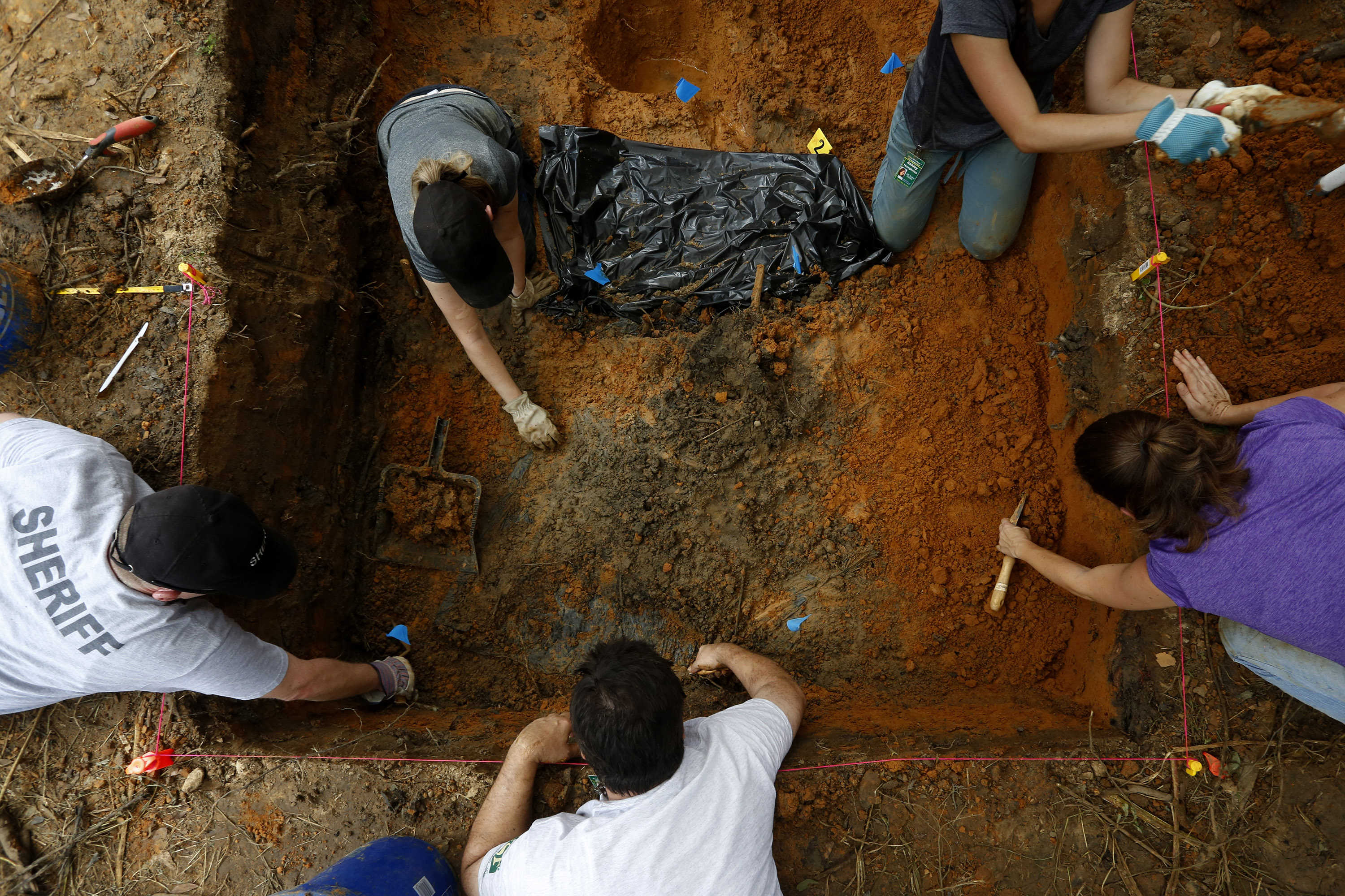Anthropologists from the University of South Florida continued exhuming gravesites in the Boot Hill cemetery at the now closed Arthur G. Dozier School for Boys in Marianna, Florida, September 1, 2013. REUTERS/Edmund D. Fountain/Pool