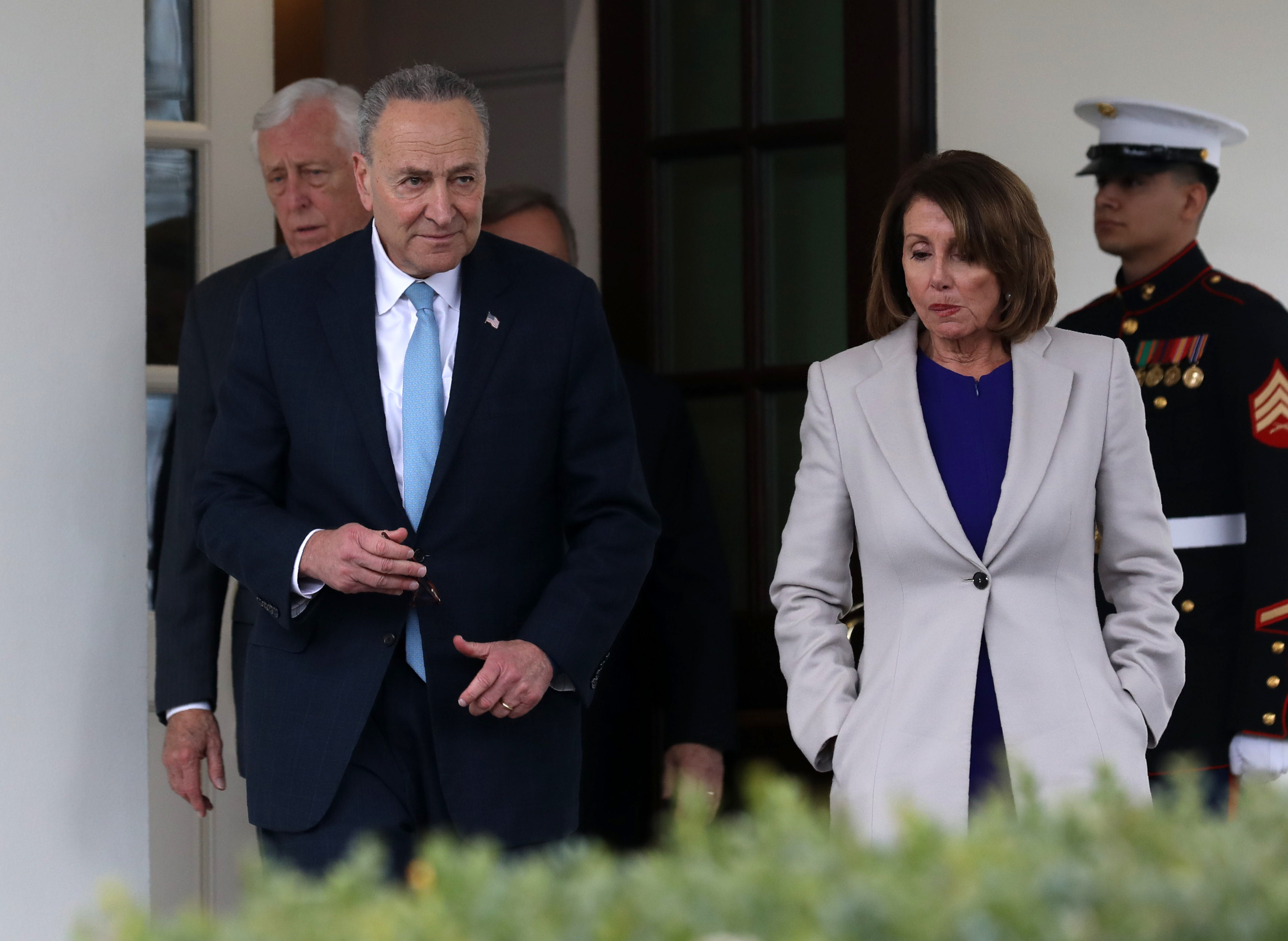 House Speaker Nancy Pelosi, Senate Minority Leader Chuck Schumer and Rep. Steny Hoyer exit the White House after meeting with US President Donald Trump (Alex Edelman/AFP/Getty Images)