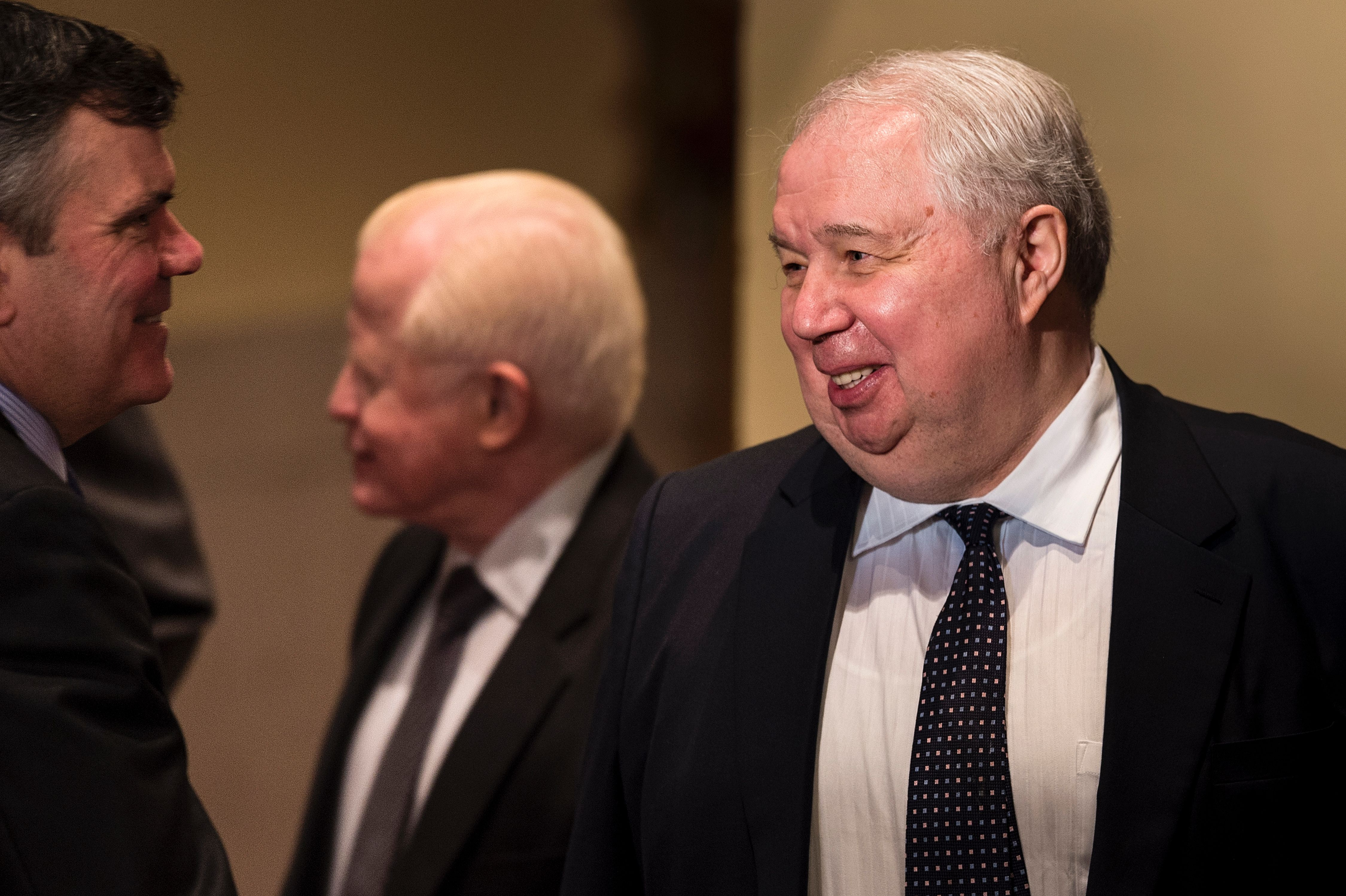 Russian Ambassador Sergey Kislyak (R) speaks with others after a foreign policy speech by President Donald Trump at the Mayflower Hotel on April 27, 2016. (Brendan Smialowski/AFP/Getty Images)