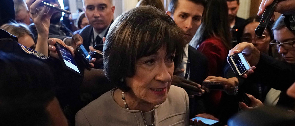 Susan Collins speaks to reporters after a floor speech to announce that she will vote for the nomination of Supreme Court Judge Brett Kavanaugh to the Supreme Court (Alex Wong/Getty Images)