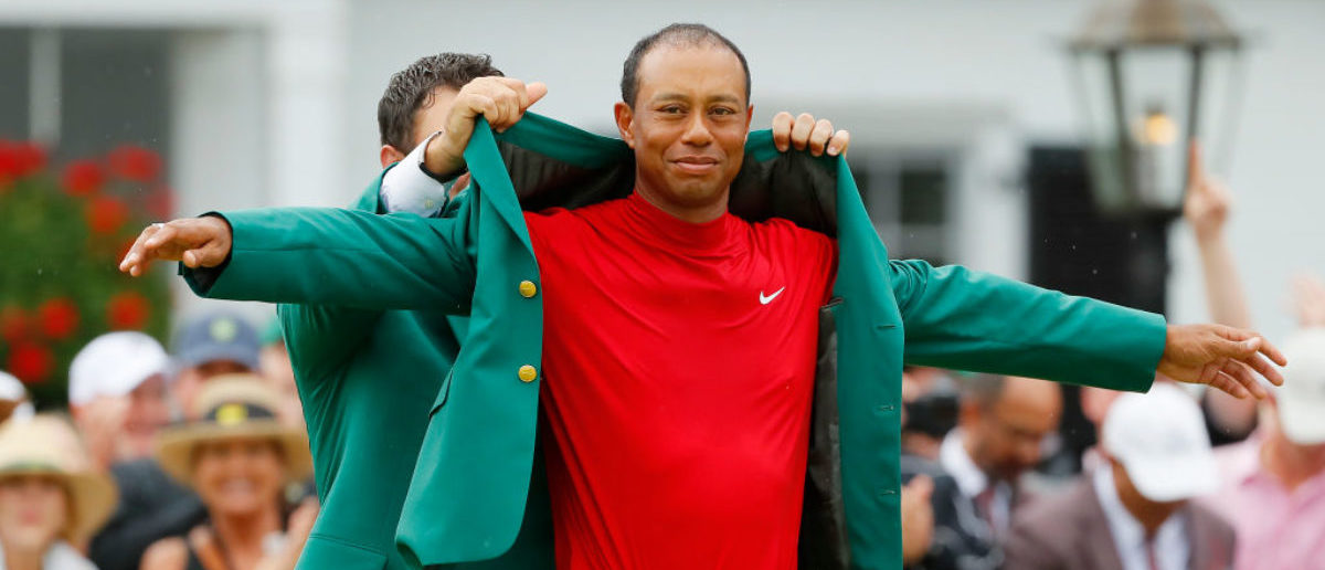 AUGUSTA, GEORGIA - APRIL 14: Tiger Woods (R) of the United States is awarded the Green Jacket by Masters champion Patrick Reed (L) during the Green Jacket Ceremony after winning the Masters at Augusta National Golf Club on April 14, 2019 in Augusta, Georgia. (Photo by Kevin C. Cox/Getty Images)