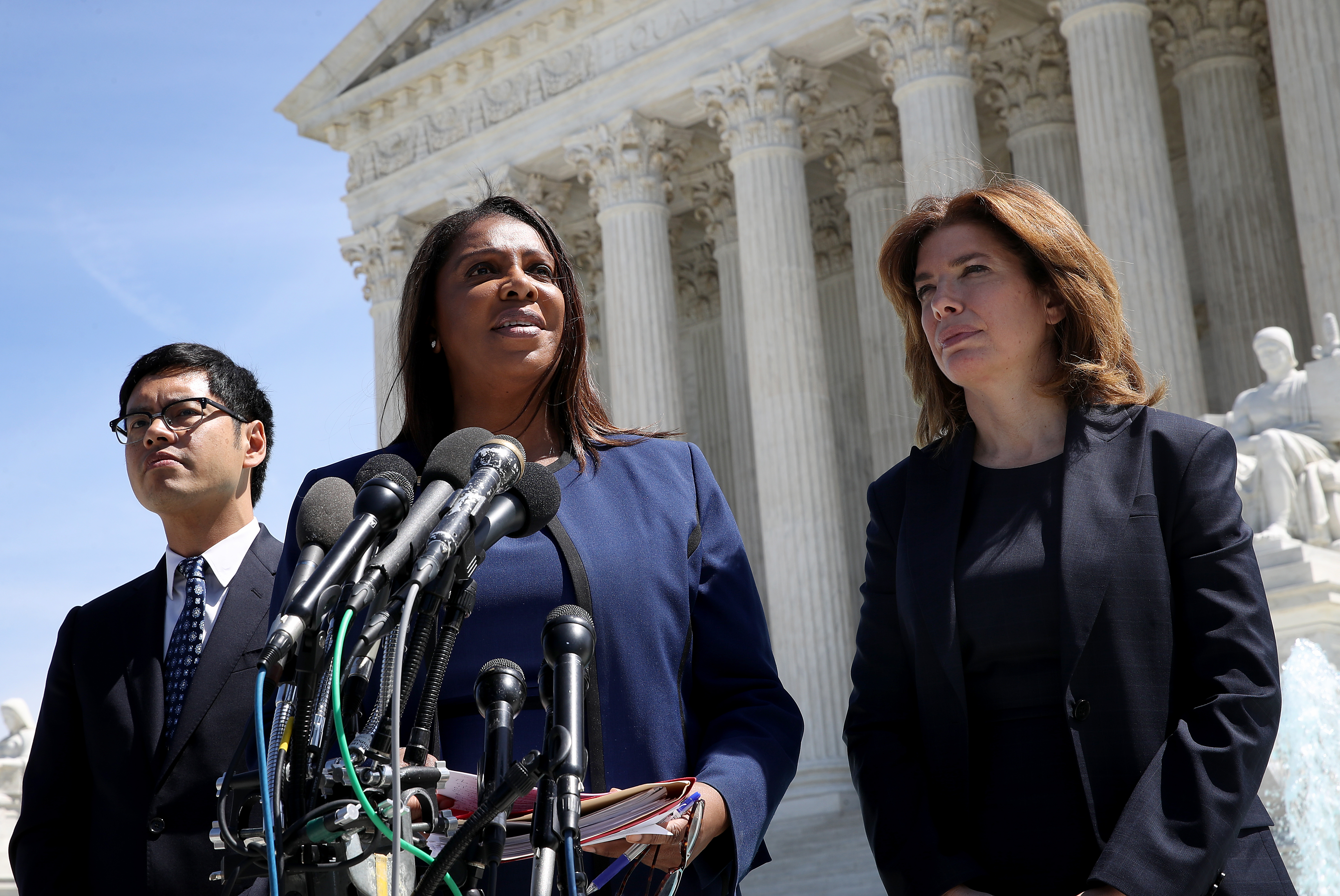 New York Attorney General Letitia James (C), New York Census Director Julie Menin (R) and the ACLU's Dale Ho (L) answer questions outside the Supreme Court after arguments in Department of Commerce v. New York on April 23, 2019. (Win McNamee/Getty Images)