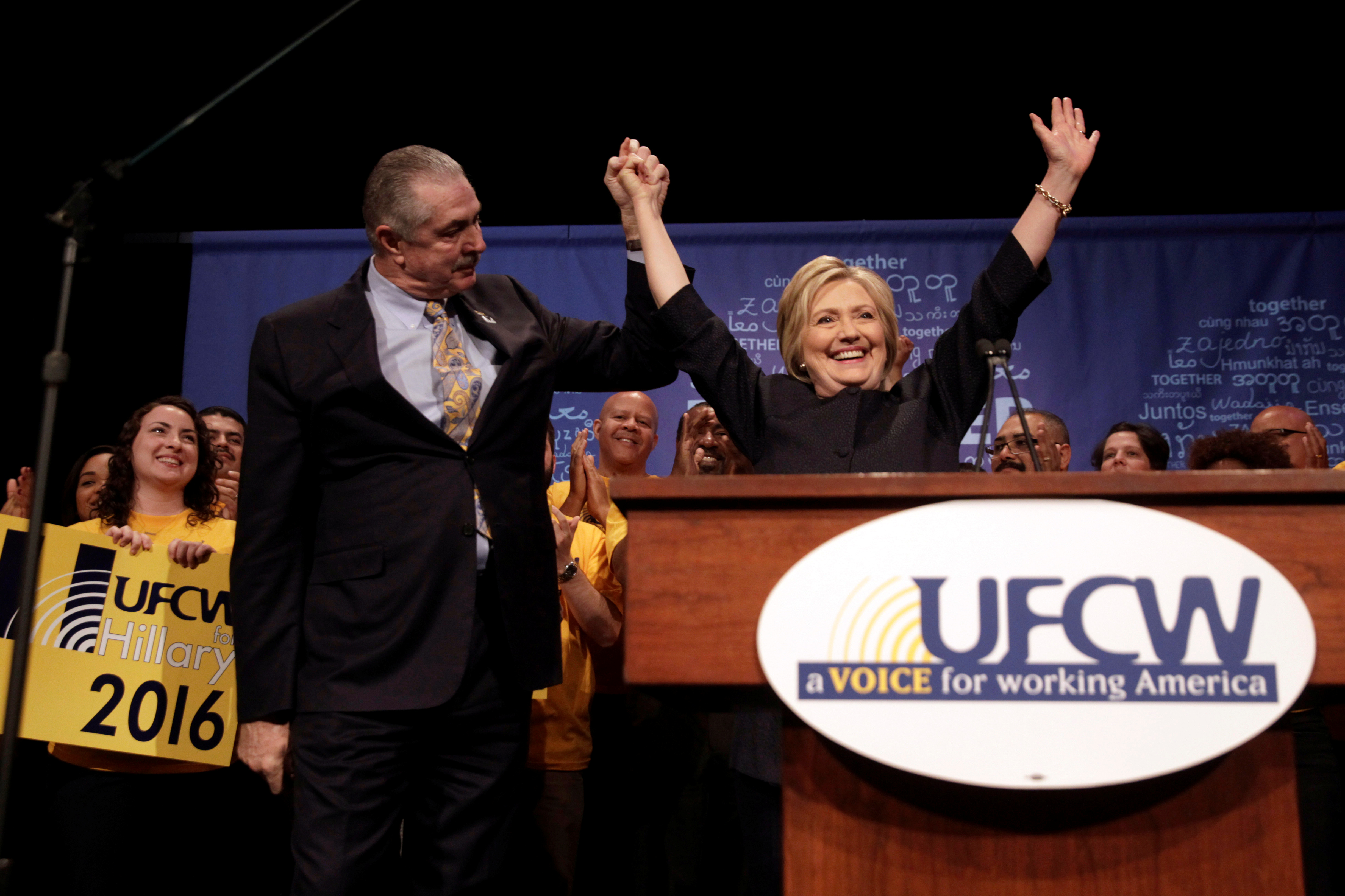U.S. Democratic presidential candidate Hillary Clinton (R) poses with United Food & Commercial Workers International President Marc Perrone after speaking to the attendees of the UFCW convention in Las Vegas, Nevada, U.S. May 26, 2016. REUTERS/Steve Marcus